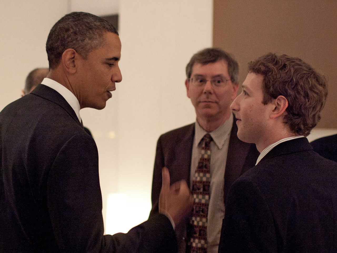 President Barack Obama talks with Facebook founder and CEO Mark Zuckerberg