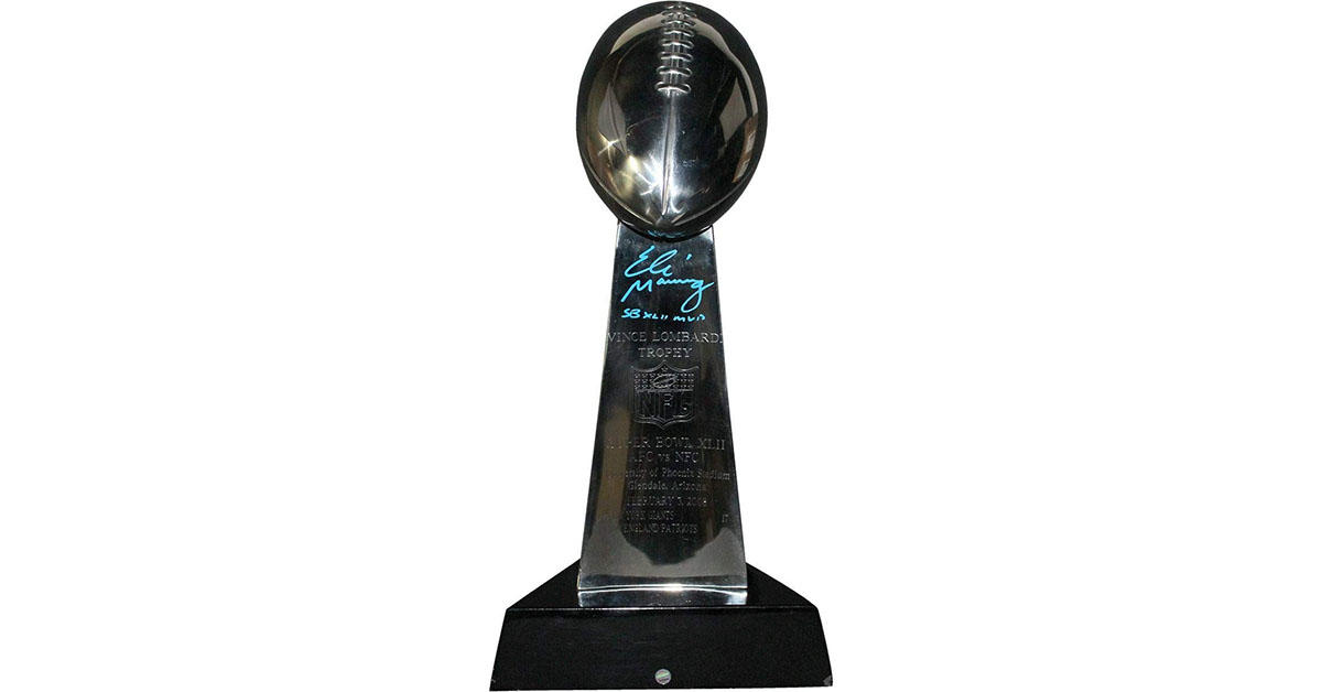 This replica Lombardi trophy signed by Eli Manning
