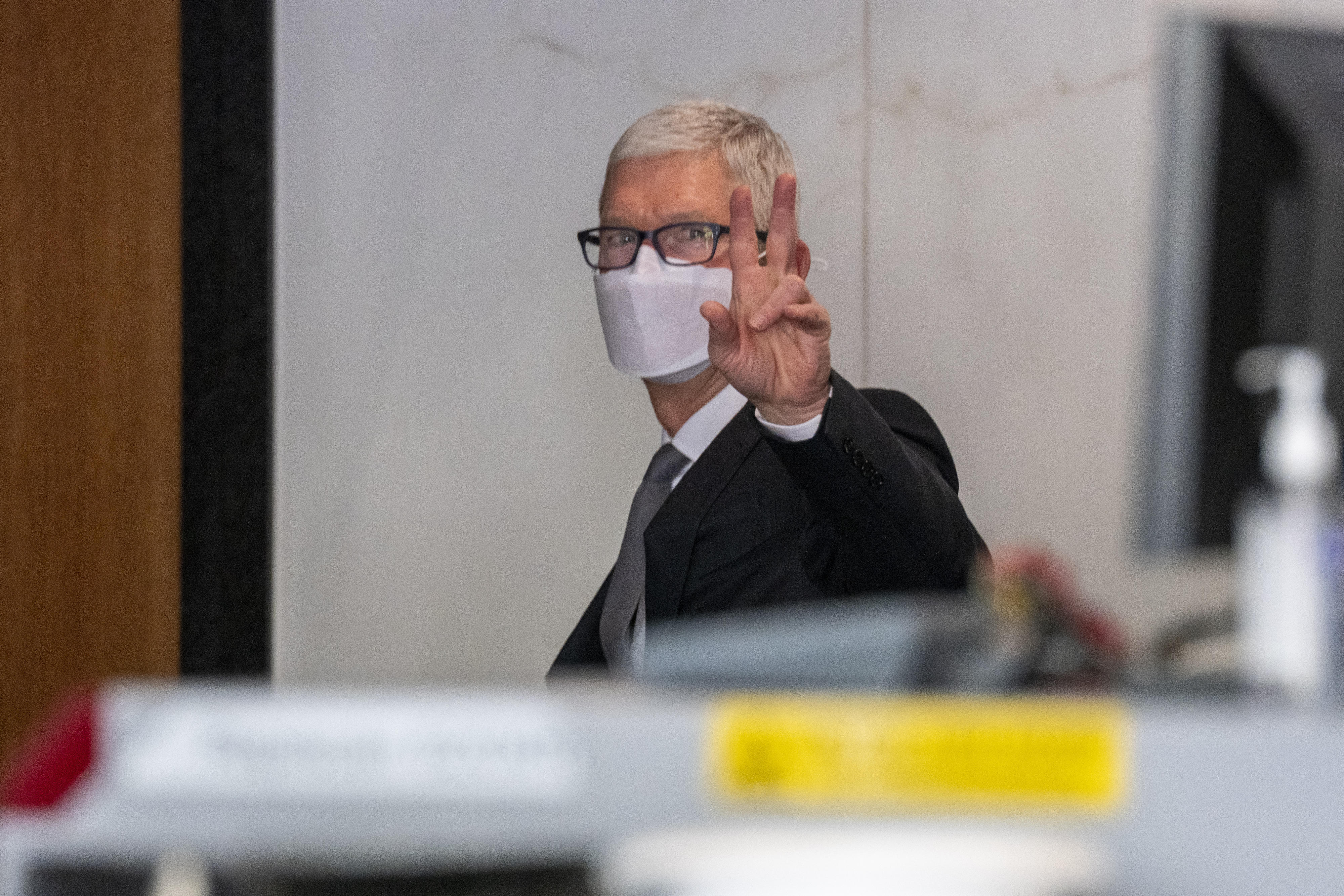 Apple CEO Tim Cook gestures while exiting US district court in Oakland, California, on Friday.