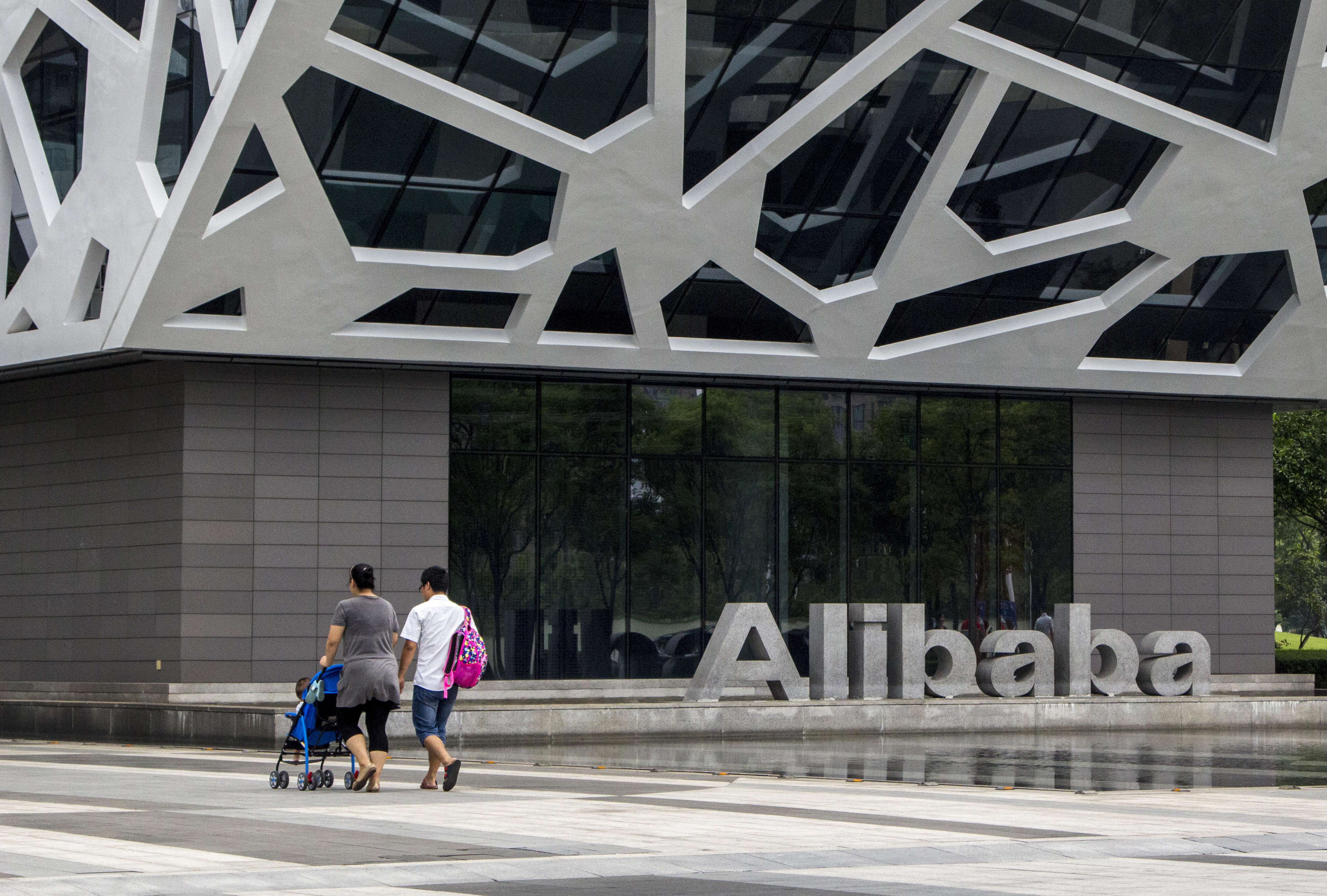 Logo and headquarter building of Alibaba Group in Hangzhou