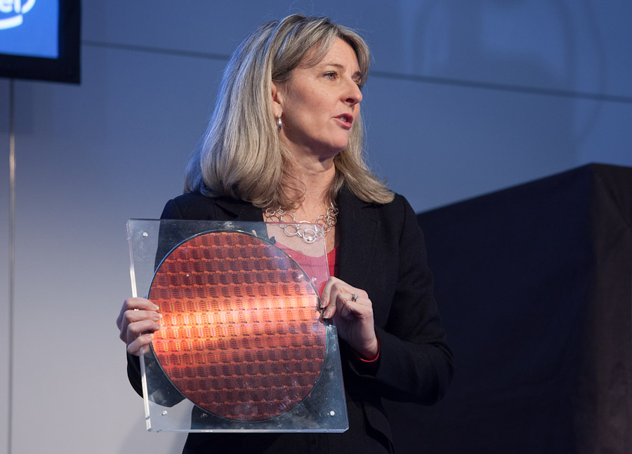 Lisa Graff, general manager of Intel's data center platform engineering group, holds a 300mm wafer of Intel's E5 Xeon processors.