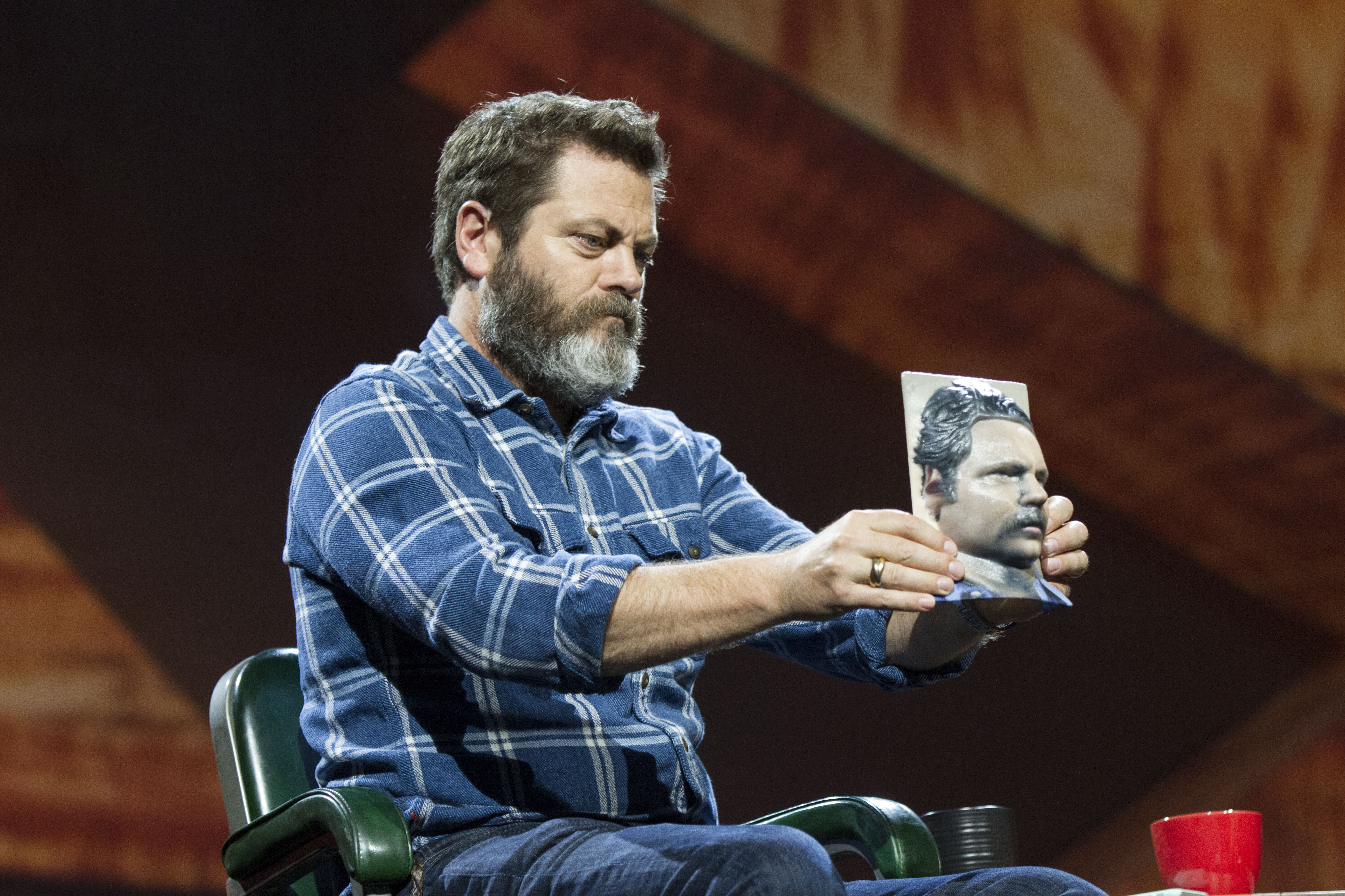 At Adobe's Max conference, Parks and Recreation actor Nick Offerman holds a 3D-printed model of his head reconstructed from a photo.