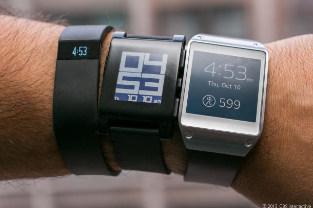 Google may join Fitbit Force, Pebble, and Samsung Galaxy Gear (l-r) in trying to earn a spot on your wrist.