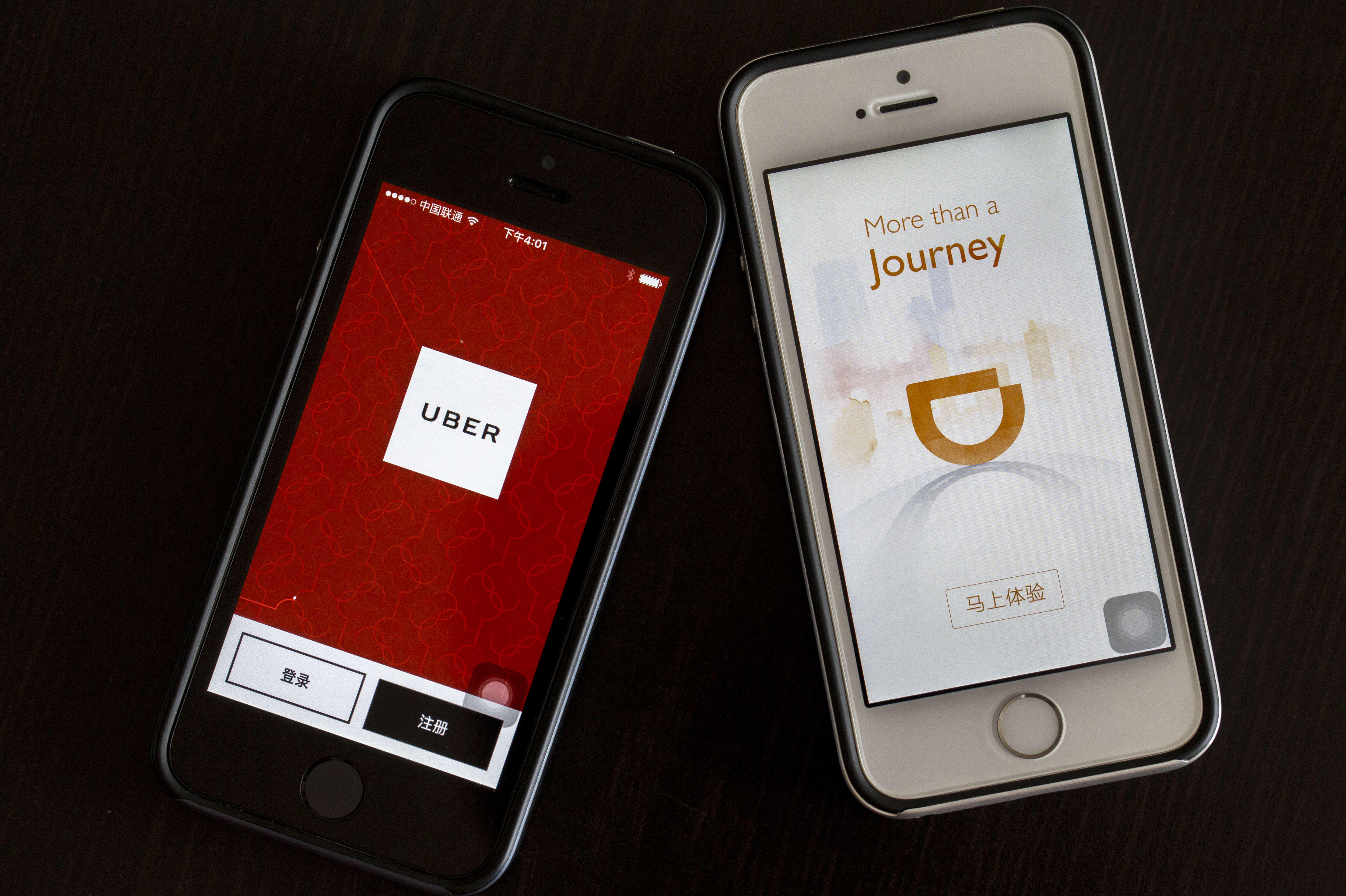 Apps of Uber and Didi Chuxing on smart phone.  Uber is