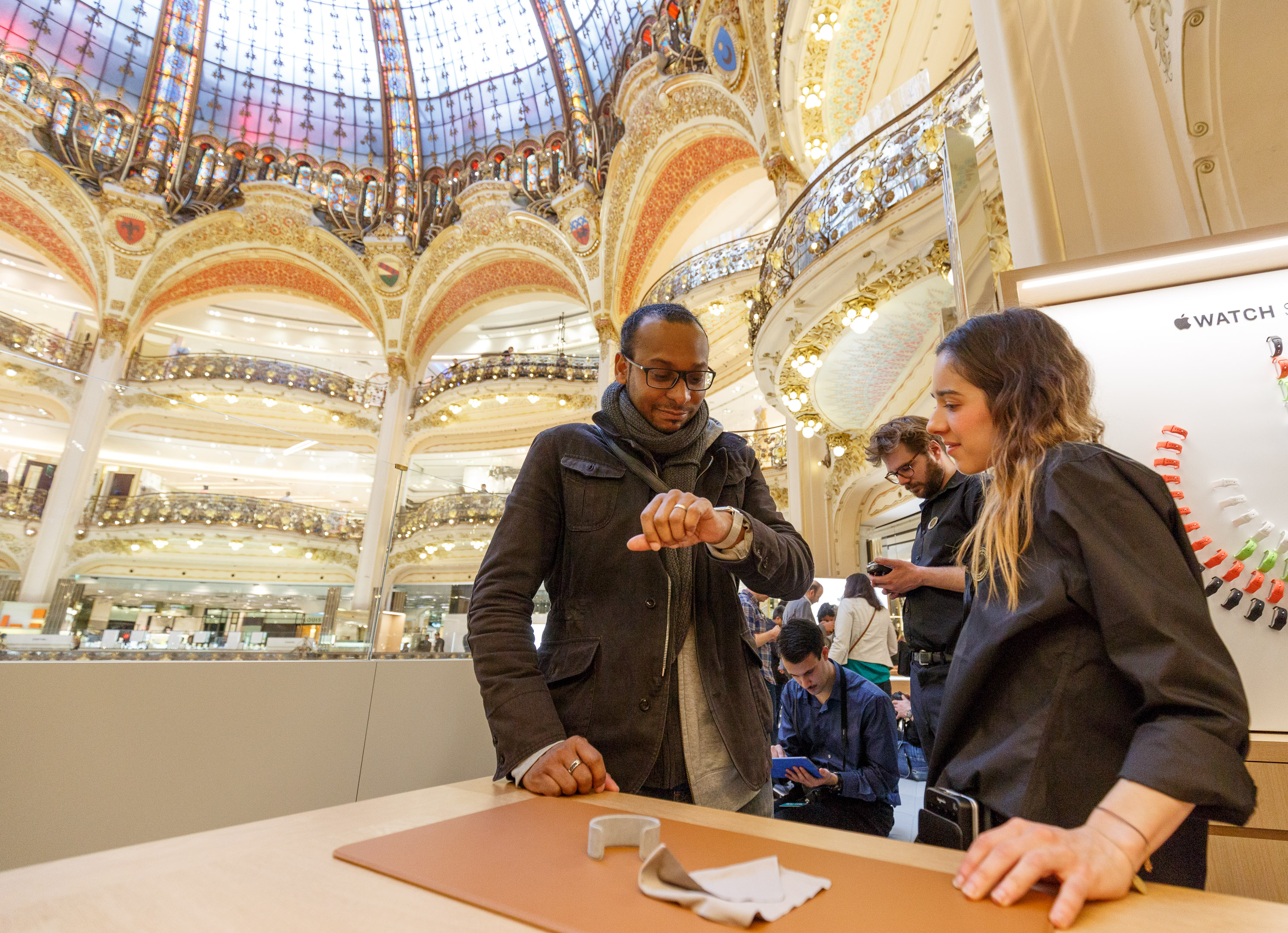 A prospective customer tries an Apple Watch during a one-on-one fitting appointment at the Galeries Lafayette, a high-end Parisian department store.