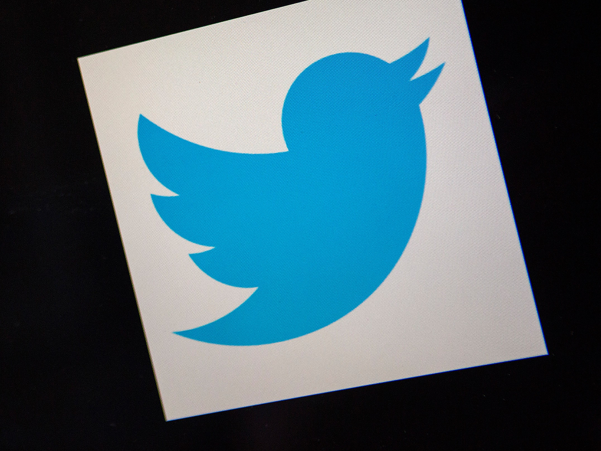 Twitter has reinstated the account of a sportswriter suspended for posting a GIF of a US Olympic gymnast.