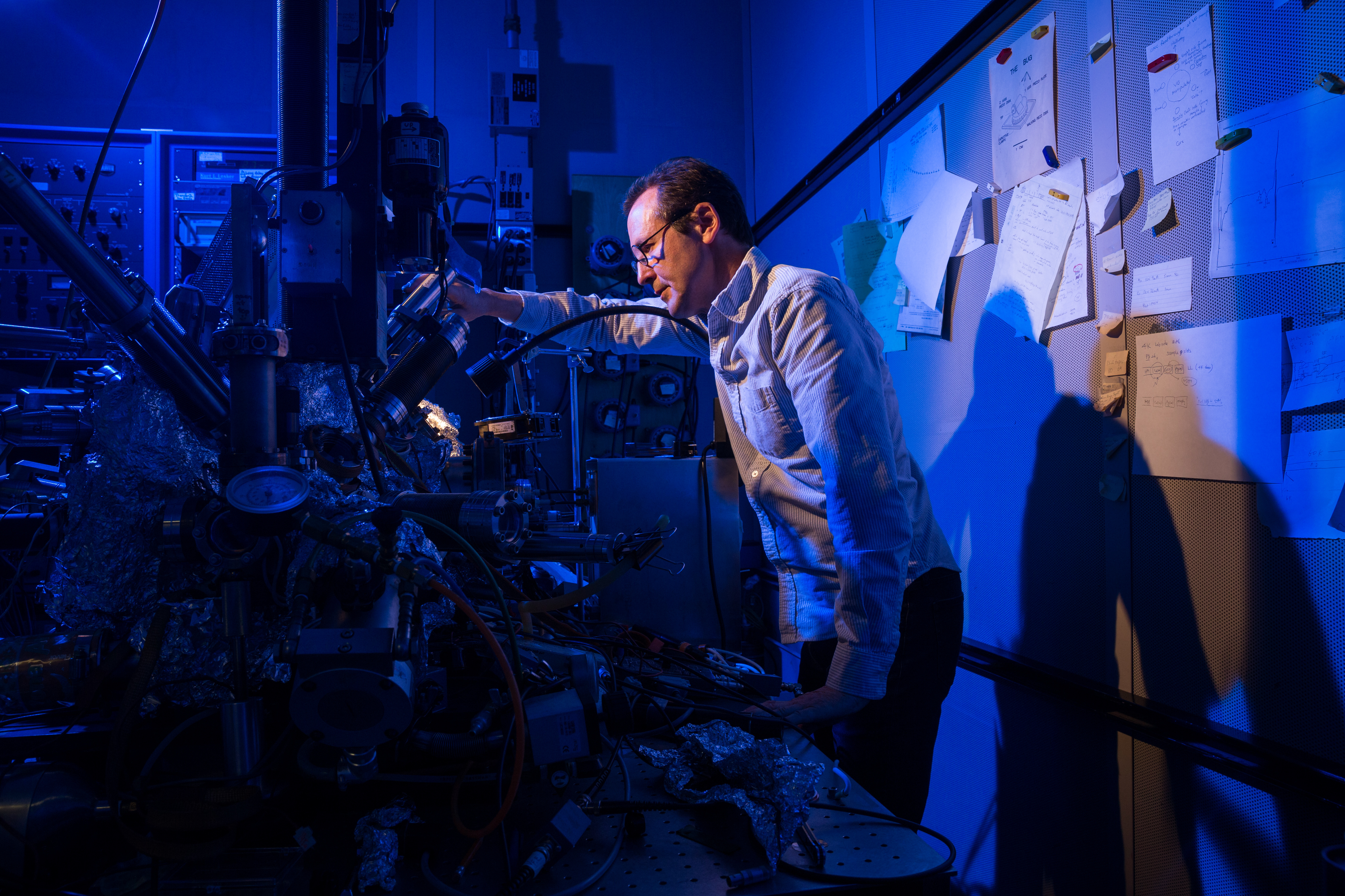 IBM researcher Chris Lutz stands by a microscope he and colleagues used to store a bit of data on a single atom at IBM Research's Almaden campus.
