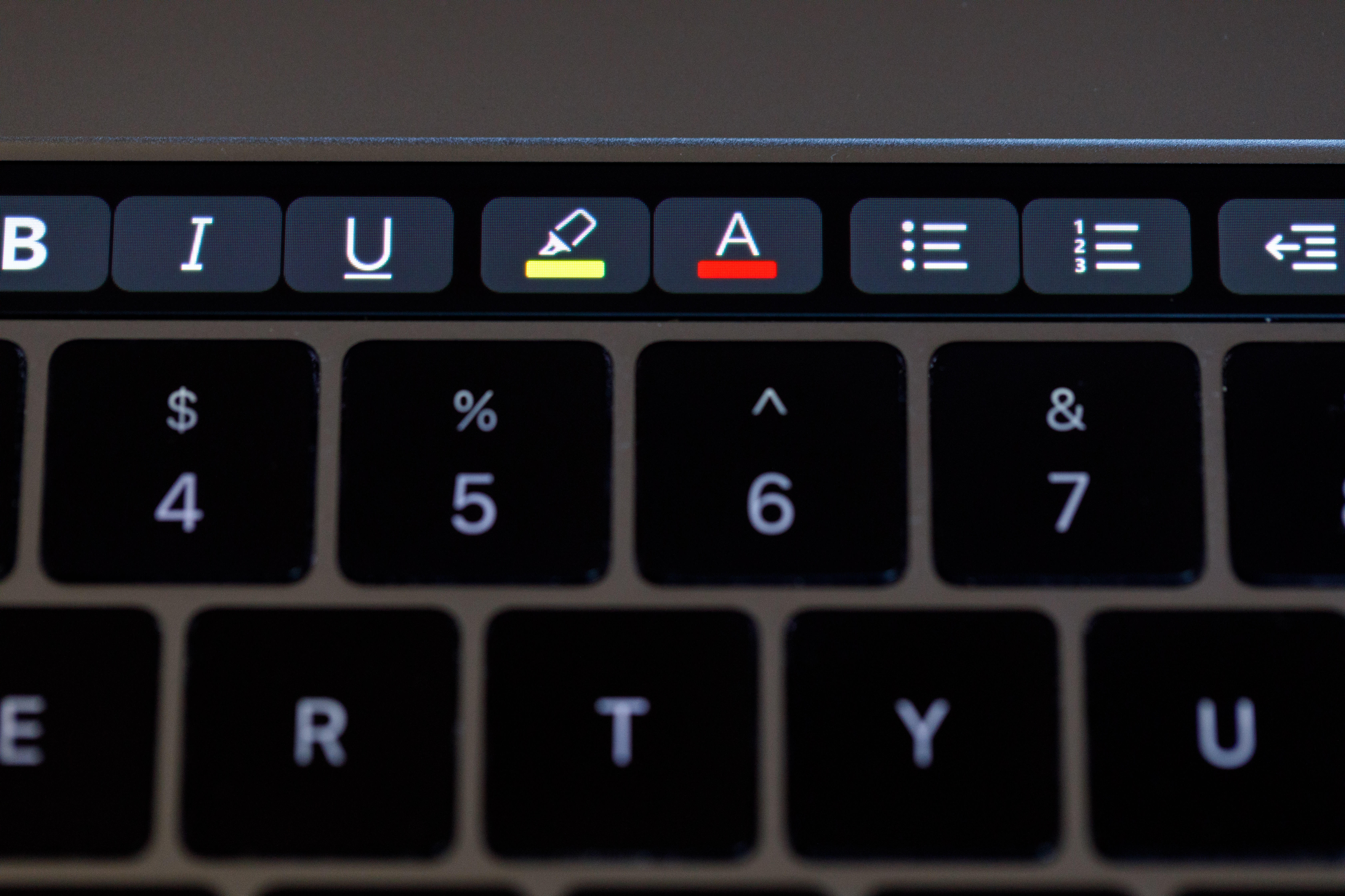 Microsoft Word offers highlight, text color, and other tools through the Touch Bar.