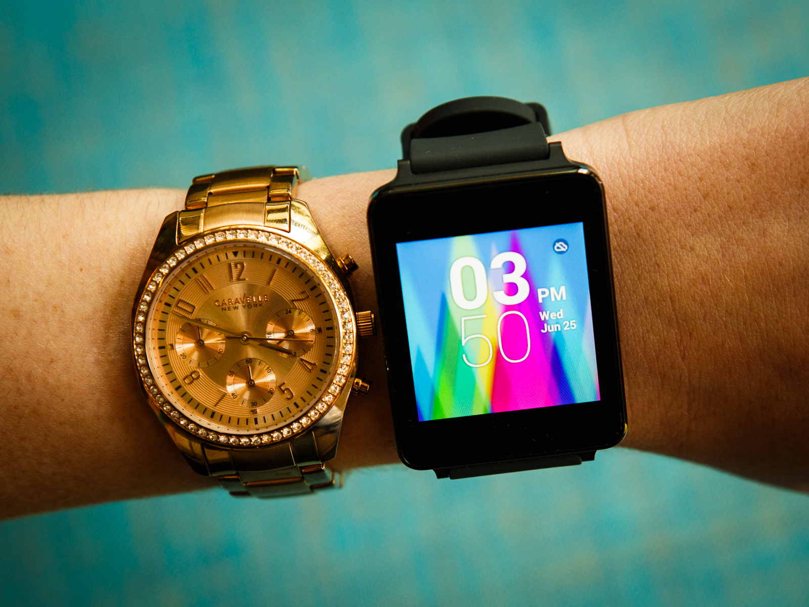 The LG G Watch (right) next to a Caravelle-made analog watch.