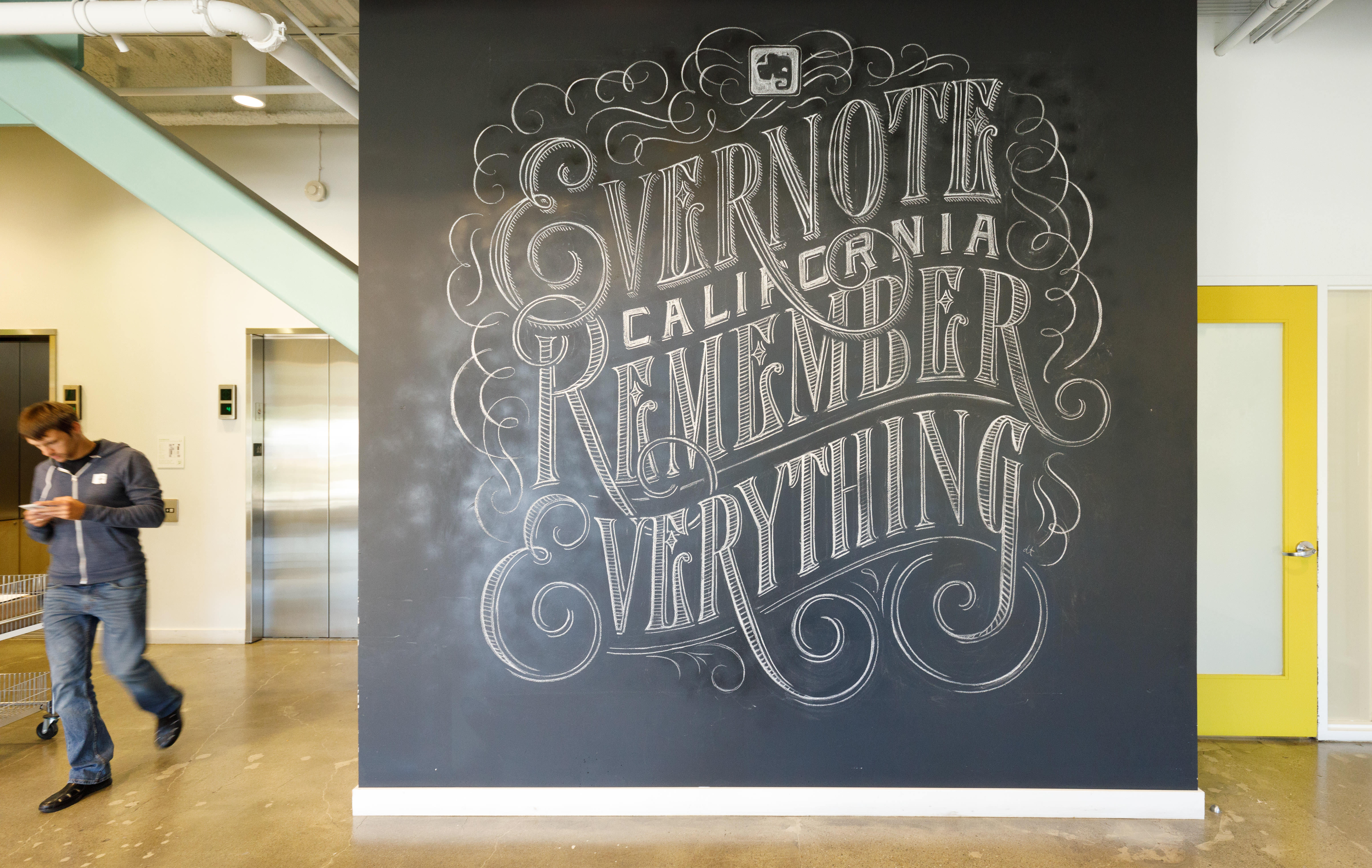 """Elaborate chalkboard calligraphy declares """"Evernote California remember everything"""" at the company's headquarters."""