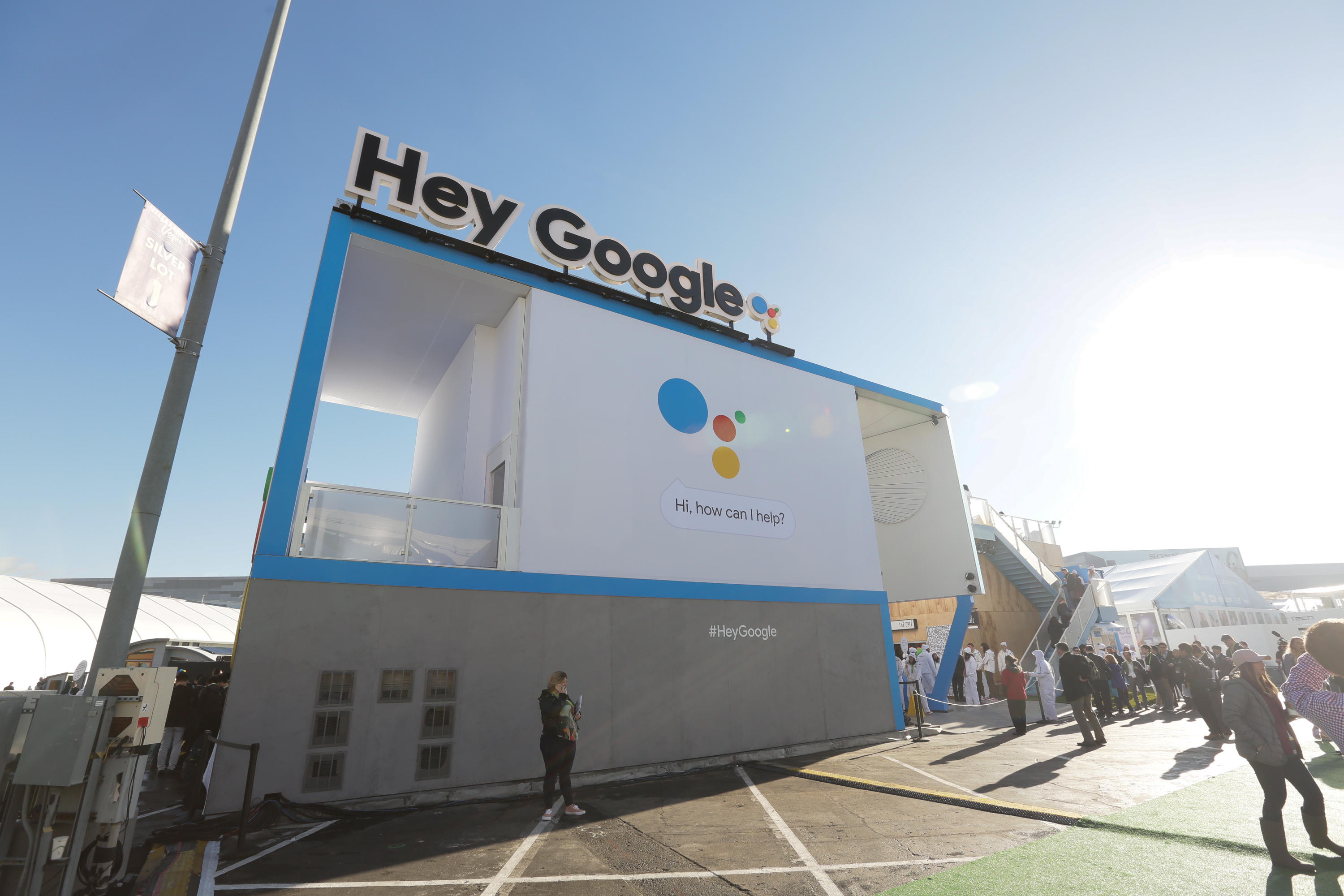 """Google CES 2018 booth with """"Hey Google"""" sign"""