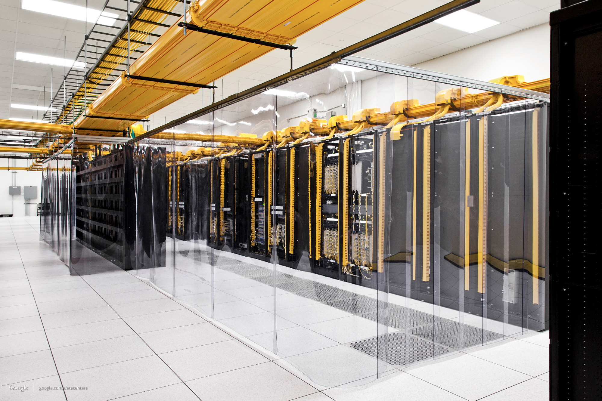 Transparent plastic curtains keep the cool air around servers in a Google data center in Council Bluffs, Iowa.