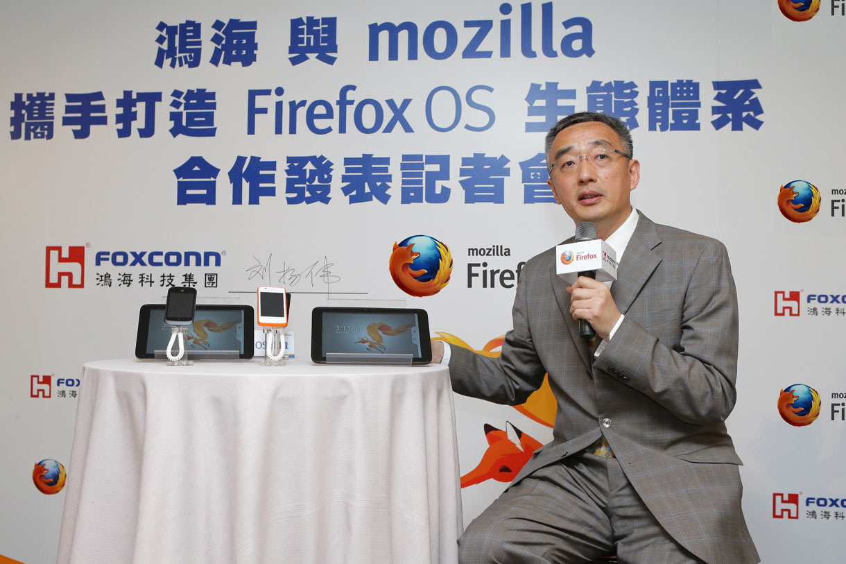 Li Gong, senior vice president of Mozilla's mobile devices effort and president of its Asian operations, shows a variety of Firefox OS devices at Computex 2013.
