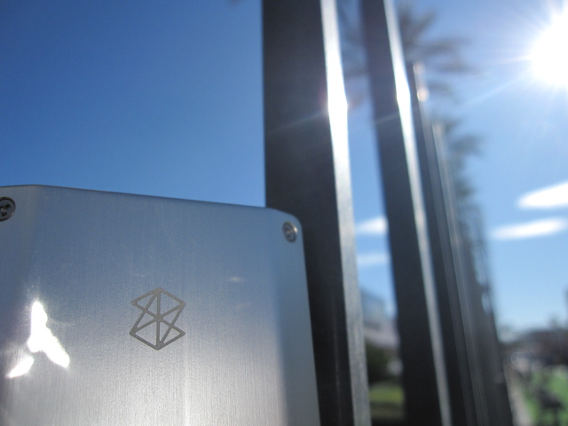 Photo of Zune HD resting on a gate.