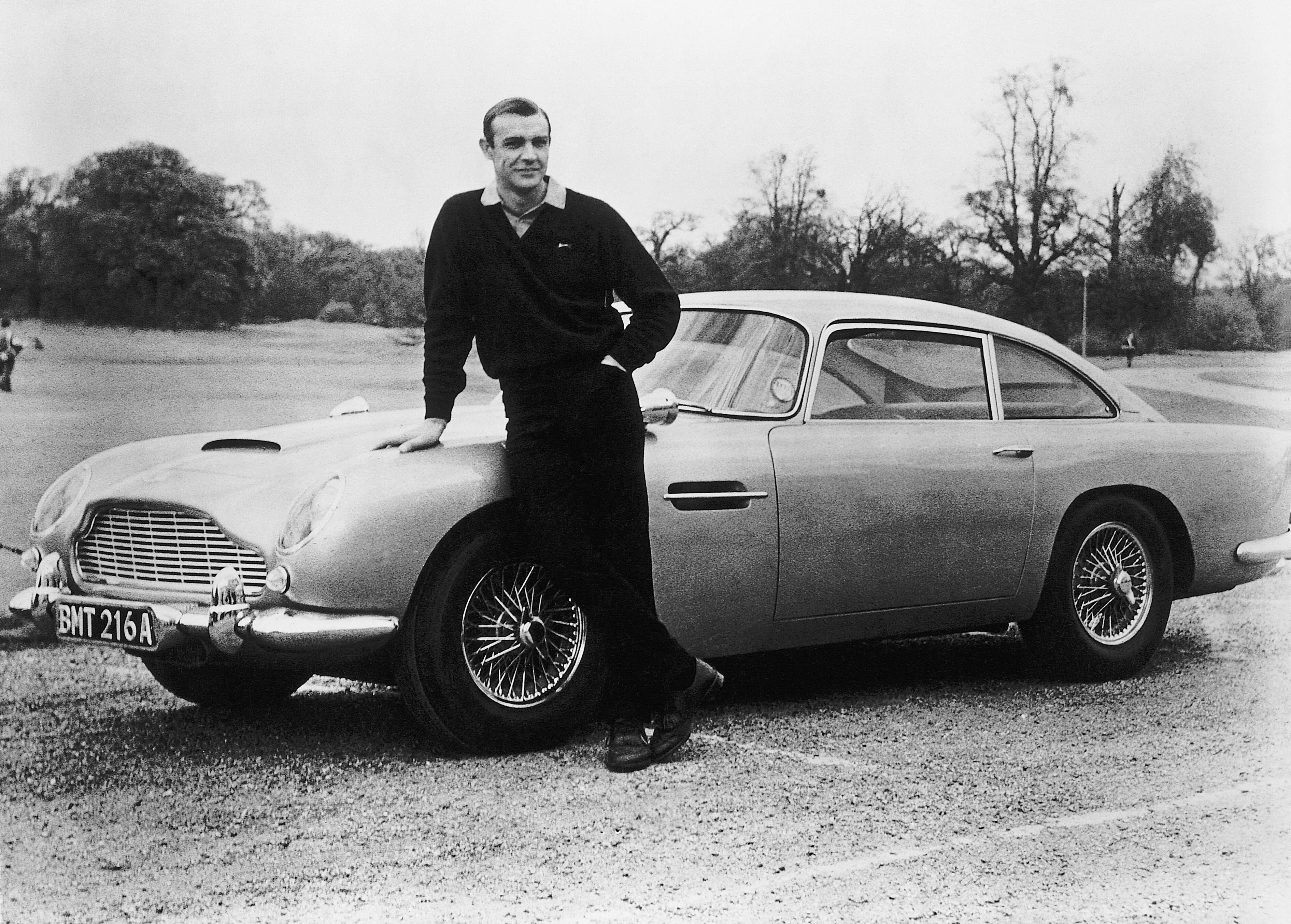 <p>Sean Connery in a relaxed moment on the set of Goldfinger, with the iconic 1964 Aston Martin DB5.</p>