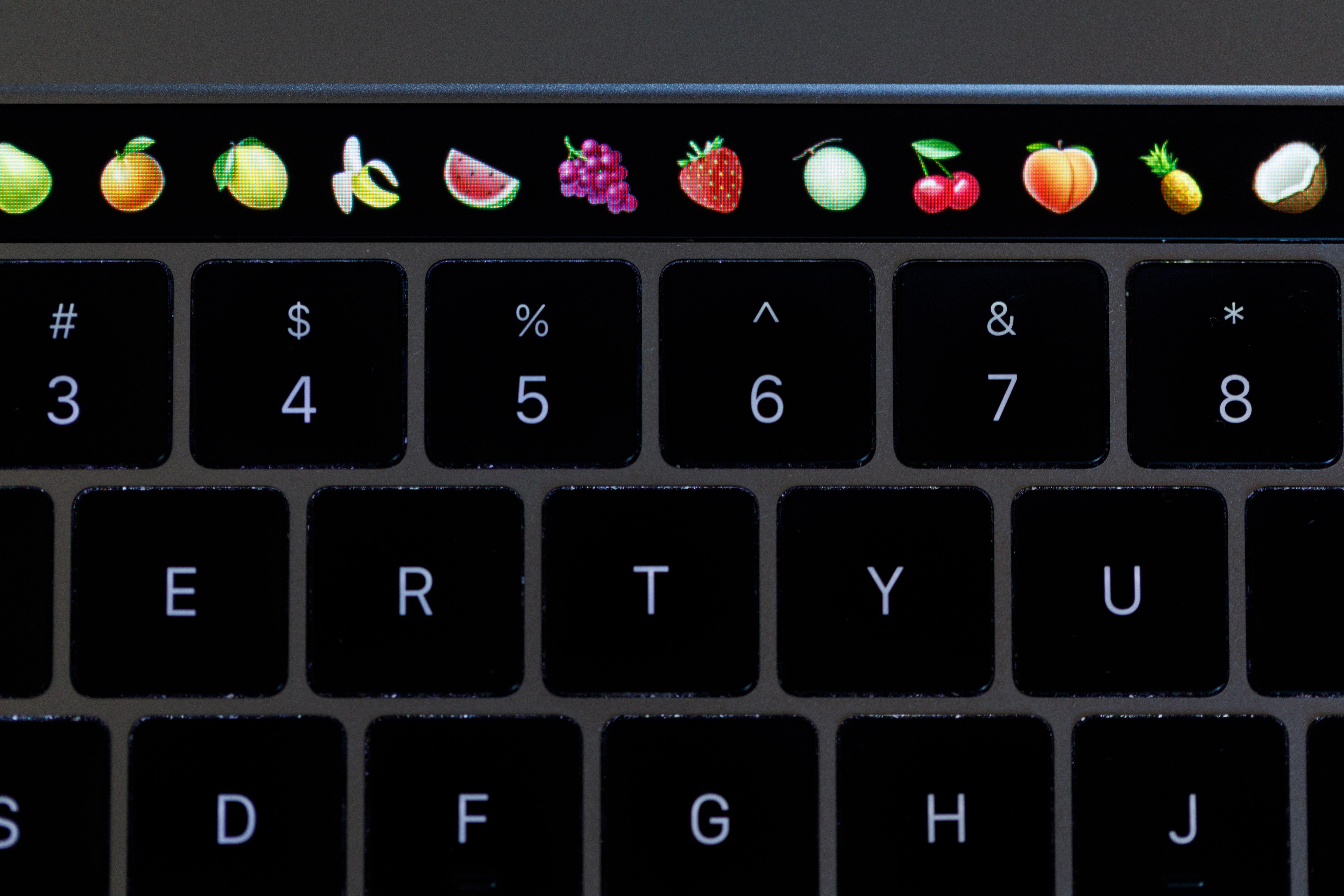 The MacBook Pro Touch Bar can be used to find emoji.