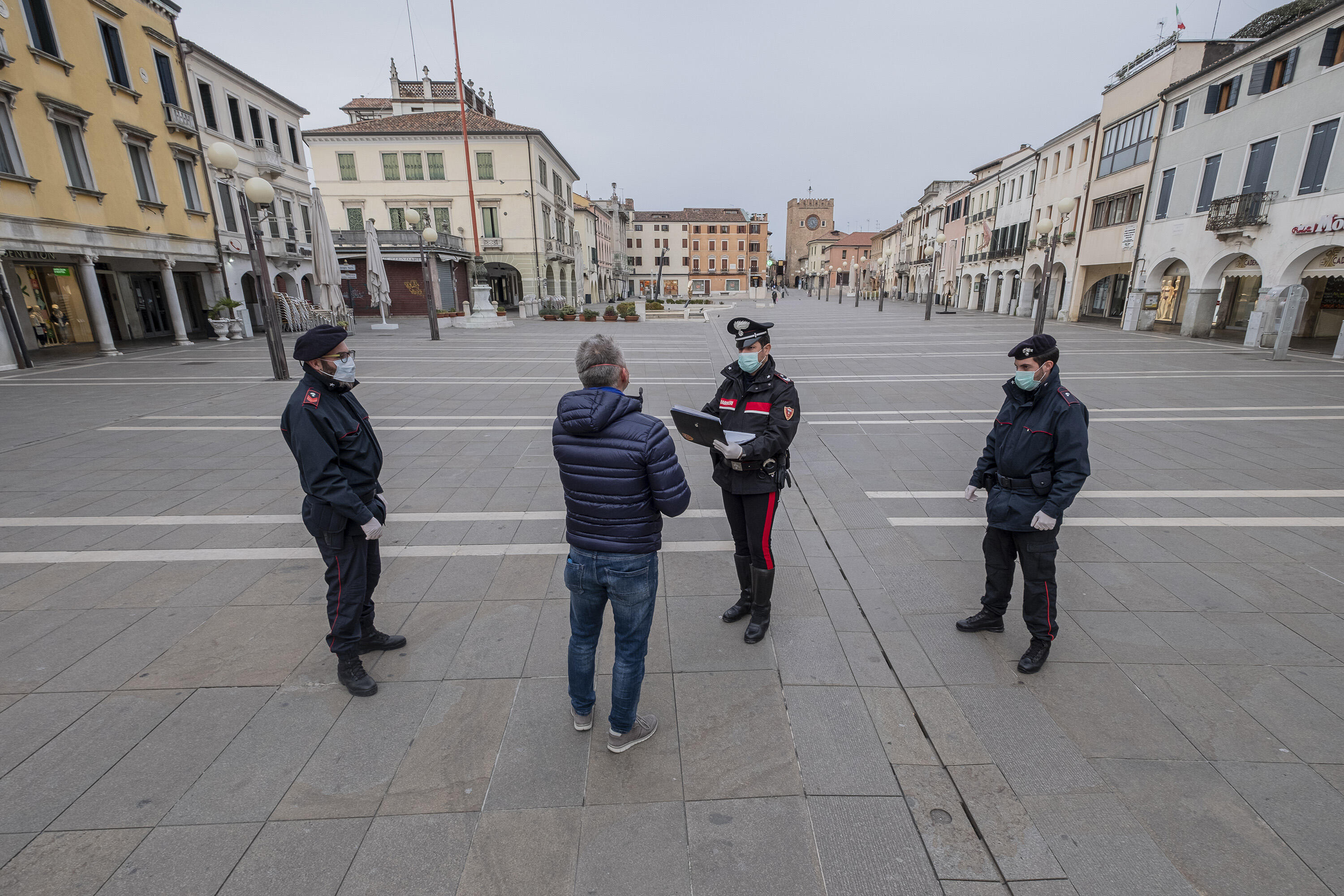 Carabinieri check a man's credentials during the coronavirus lockdown