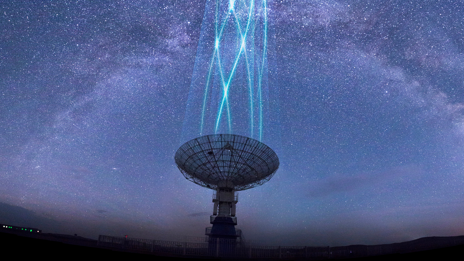 Satelllite dish aimed at a starry sky