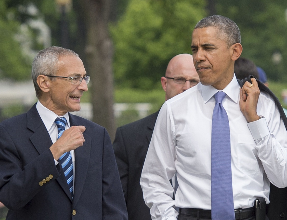 """""""Now, about those little green men..."""" Podesta strolls with Obama."""