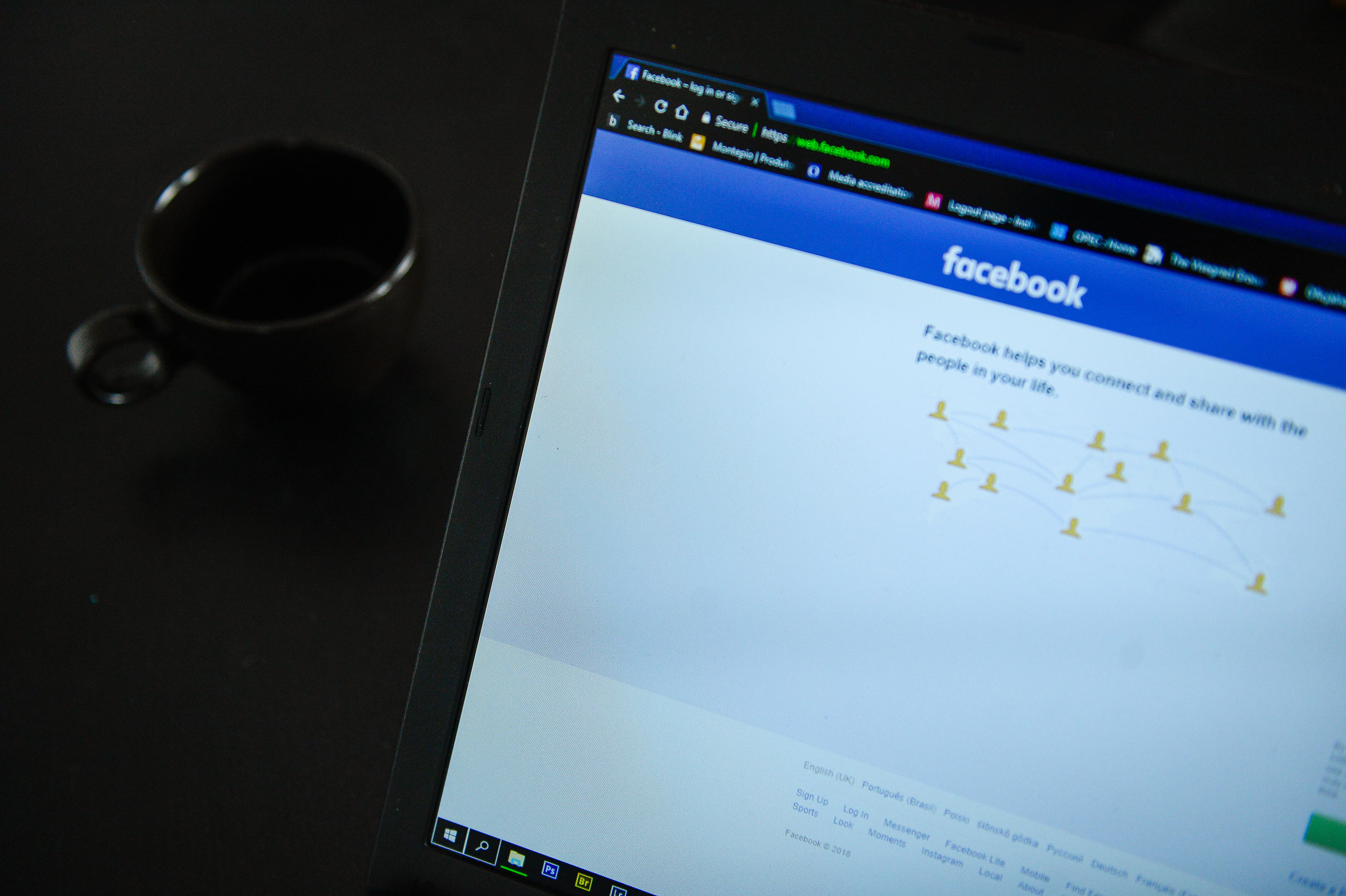 Facebook log in page is seen in a laptop