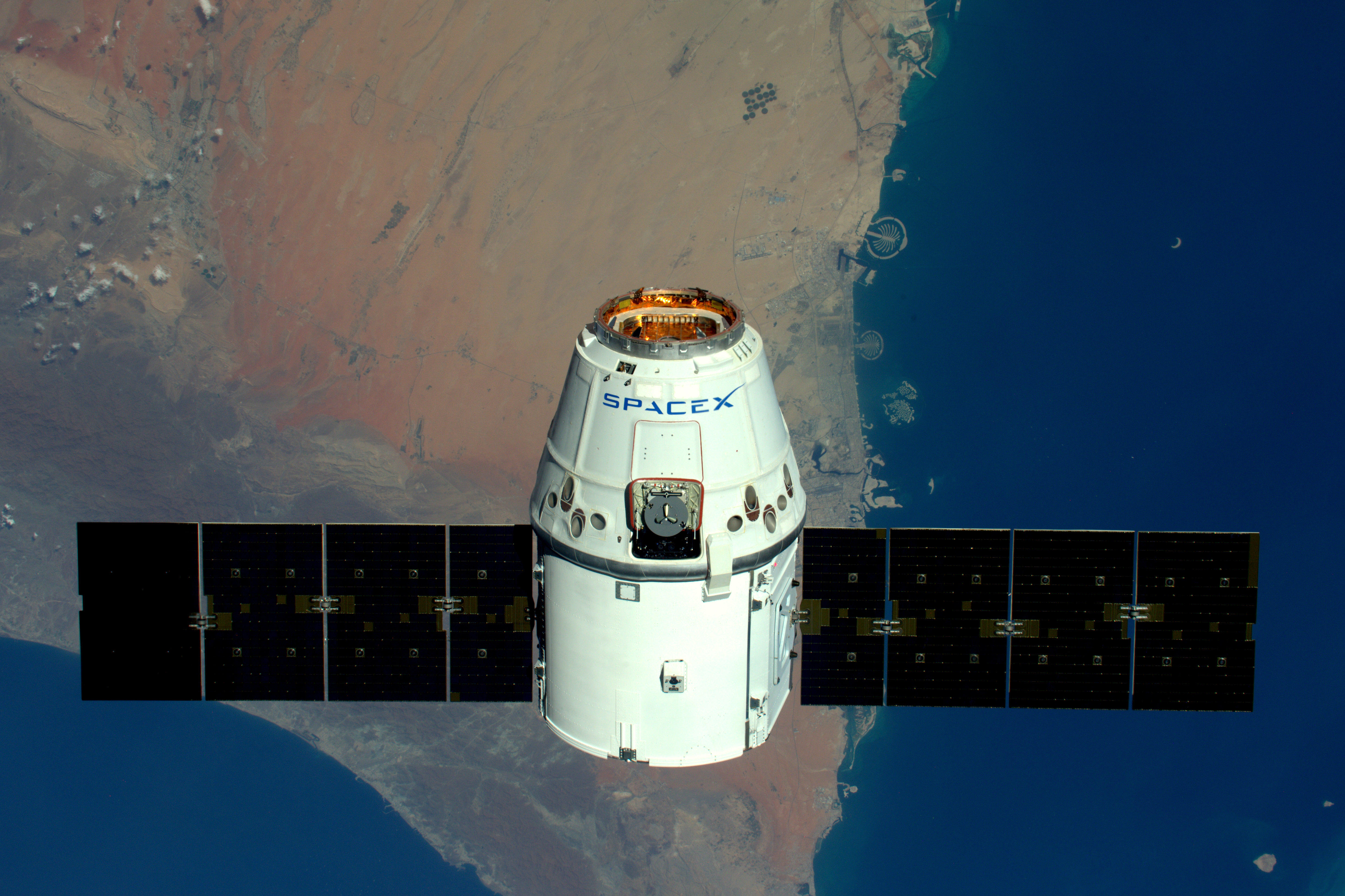 A SpaceX capsule above the Earth