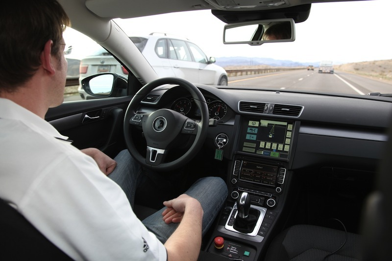 A driver behind the wheel of Continental's highly automated Volkswagen Passat.