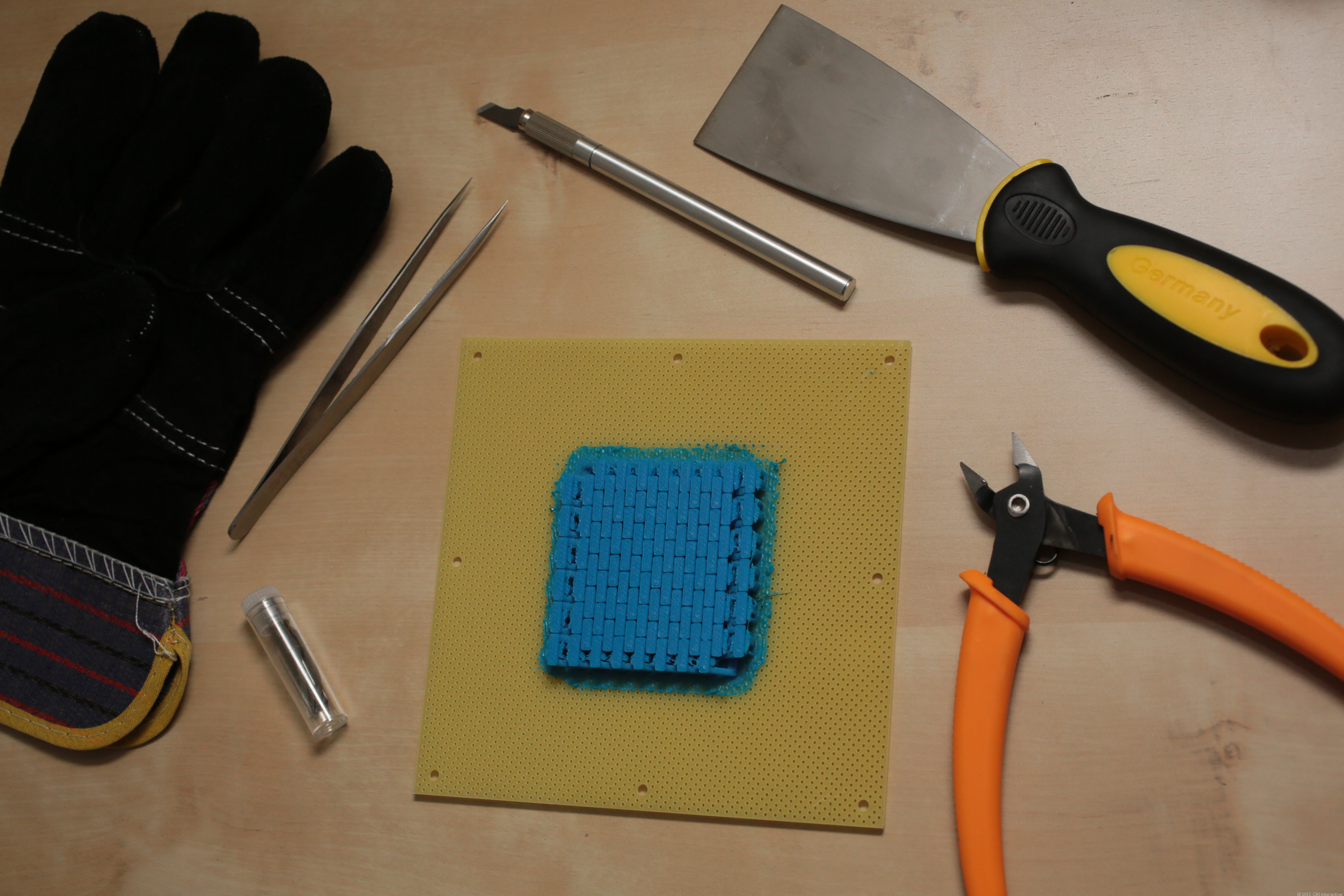 An assortment of tools included with the printer.