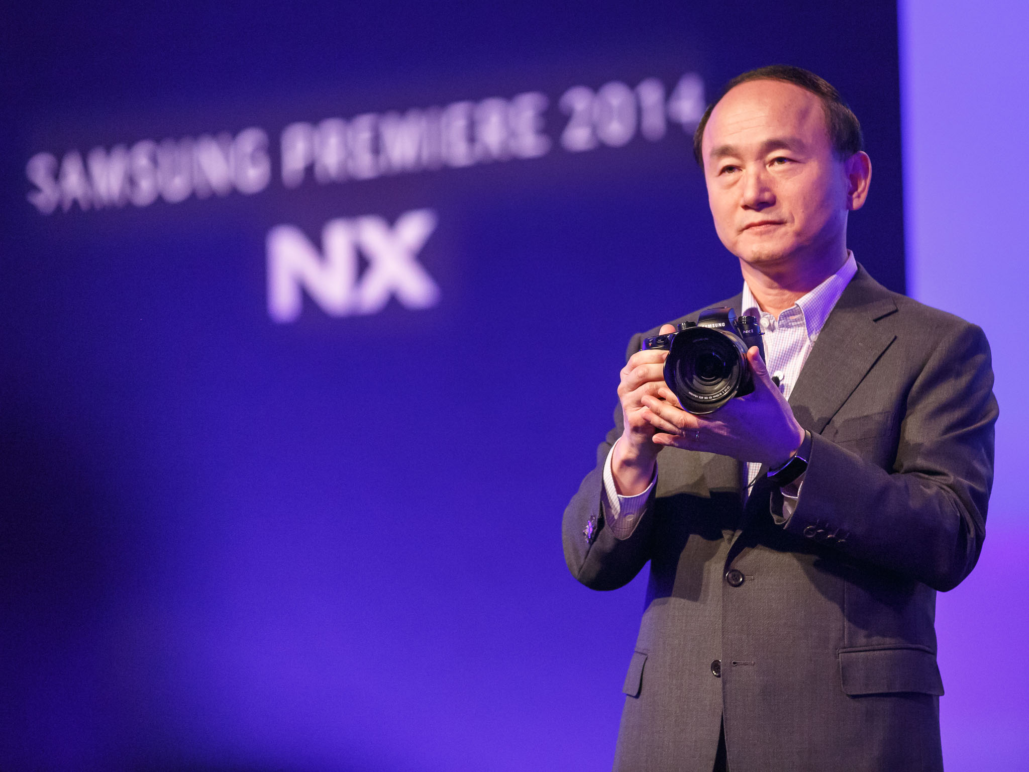 Myoungsup Han, head of Samsung Electronics' imaging team, unveils the NX1 camera in 2014. The camera can shoot 4K video compressed with the HEVC/H.265 technology.