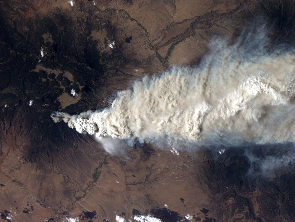 An International Space Station crew member took this photo of the Las Conchas fire near Los Alamos, N.M., on Monday, June 27, the fire's second day. The green mountains to the left (west) are the Jemez Mountains, a large volcano featuring a sunken ring-shaped caldera left from its last massive eruption 1.1 million years ago. The city of Los Alamos s just above the edge of the smoke where the green Jemez forests fade to a more arid brown. The Rio Grande flows from near the upper right corner to the lower left.