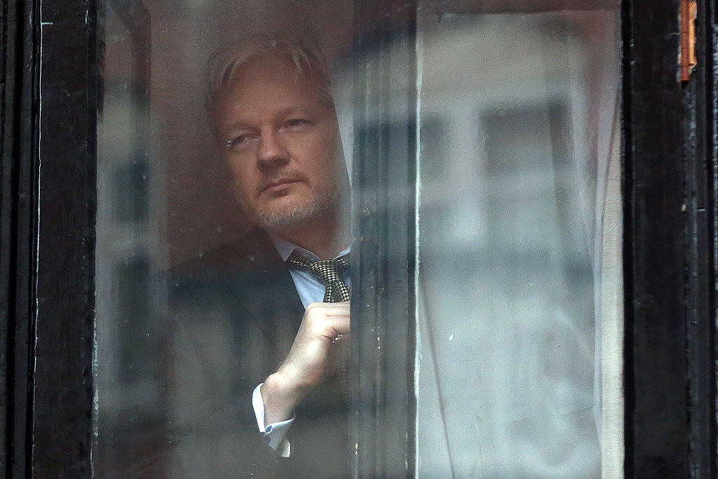 WikiLeaks founder Julian Assange prepares to speak from the balcony of the Ecuadorian embassy, where he's lived since 2012.