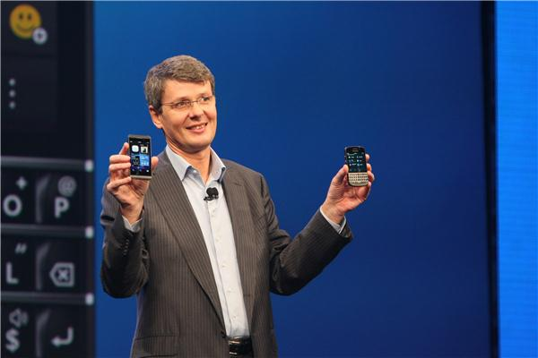 BlackBerry CEO Thorsten Heins showing off the Z10 (right) and Q10.