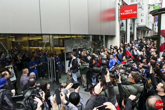 A sea of Apple Store employees meet a much larger sea of first-generation iPad buyers, press, and other onlookers in April, 2010.