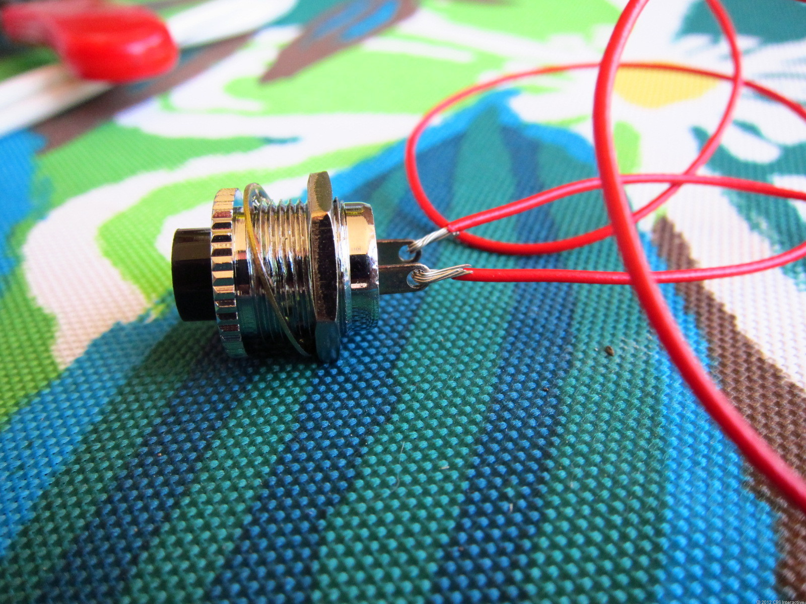 Photo of wiring up a basic momentary switch.
