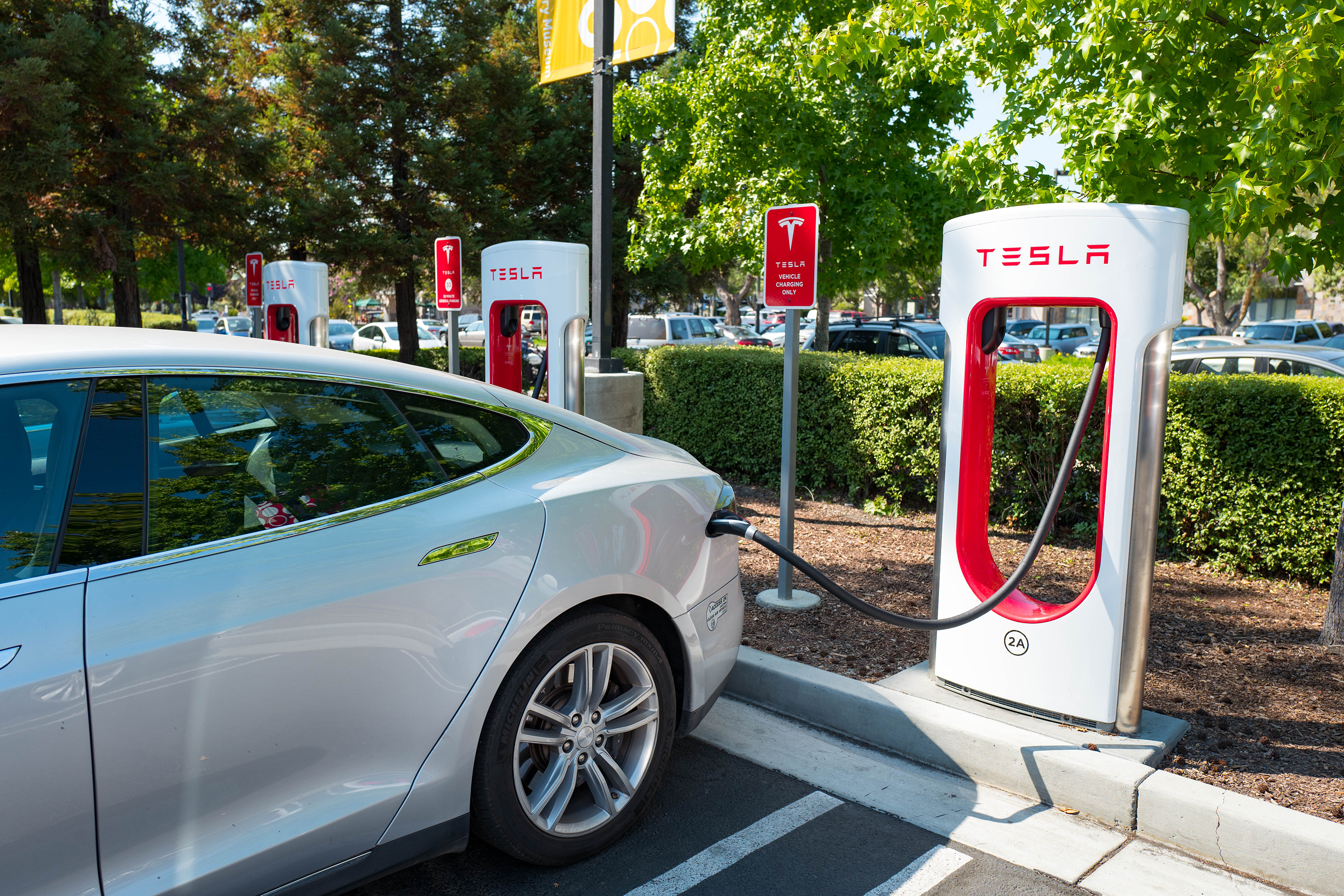 Hybrid vs electric cars buying guide: Tesla charging station