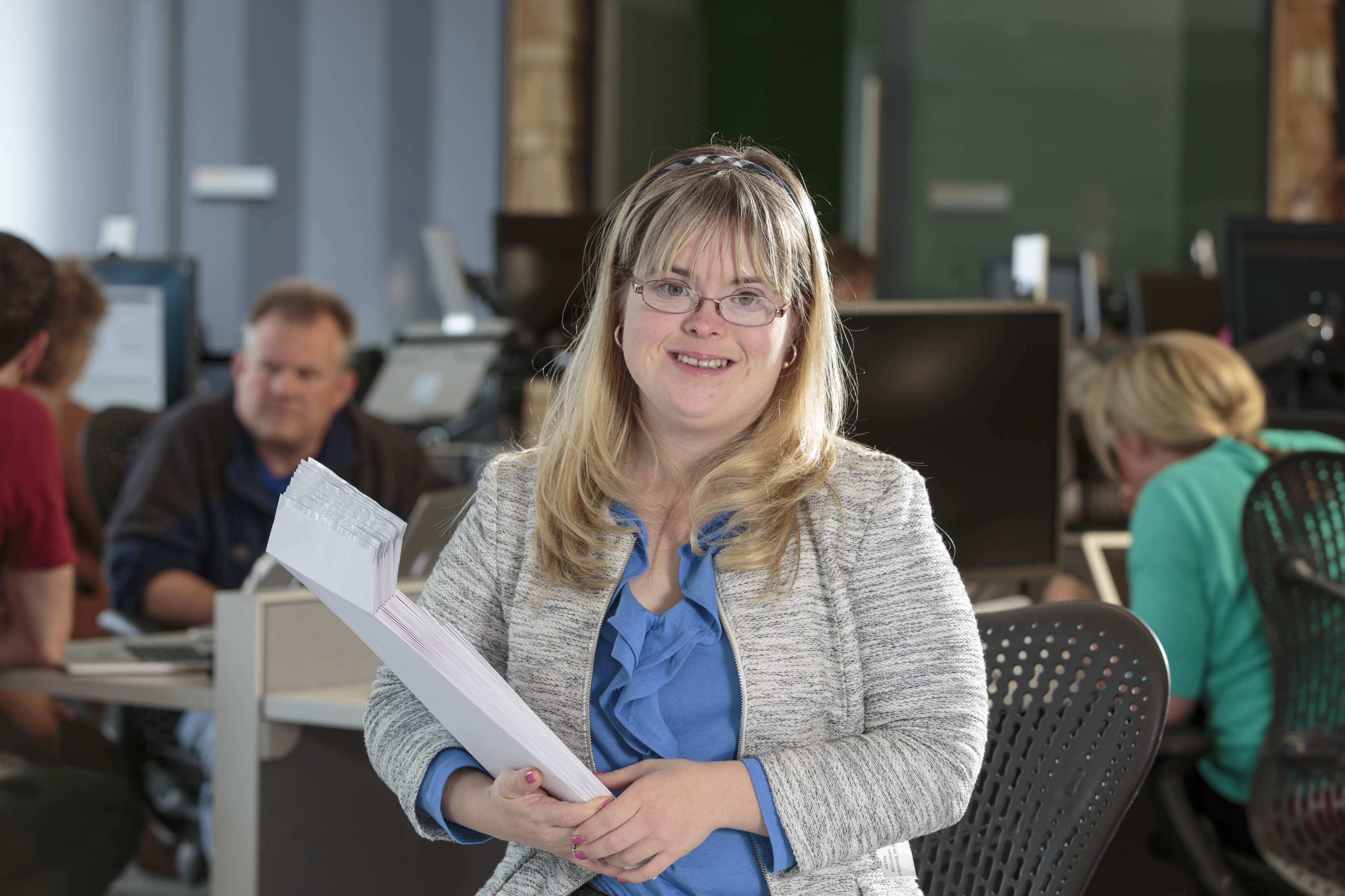 Kate Bartlett, who has Down syndrome, has been working as a benefits assistant at Aquent for 11 years, where she uses technology skills to do her job.