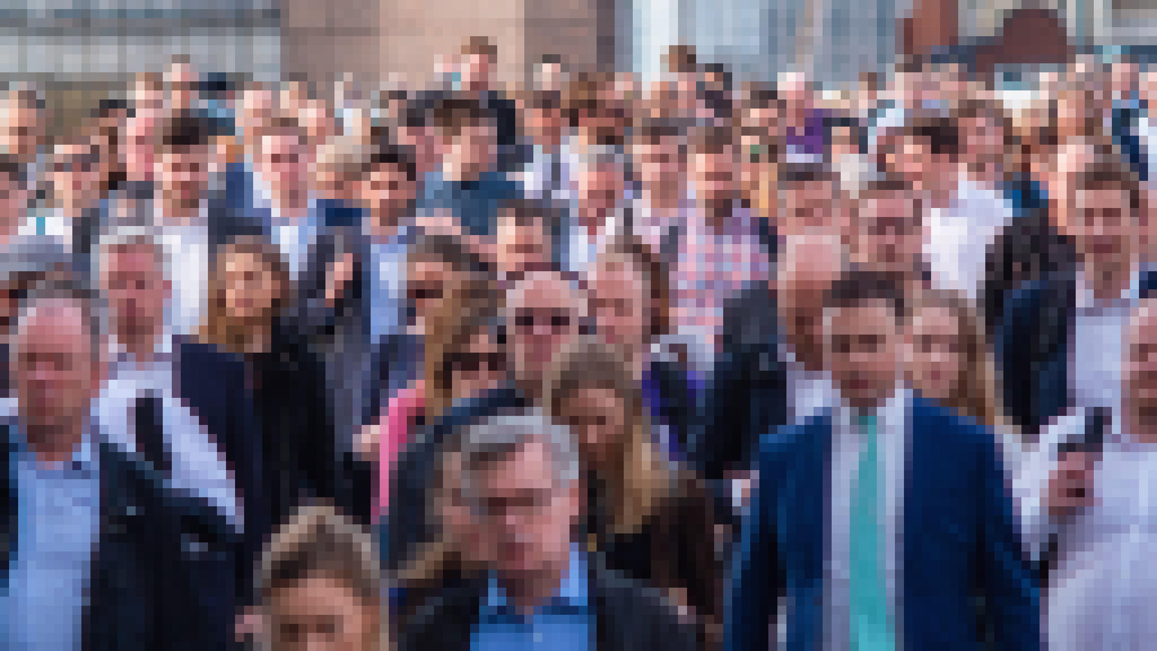 Pixelated image of commuters making their way to work