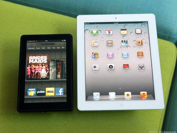 Amazon's 7-inch Kindle Fire next to the iPad.