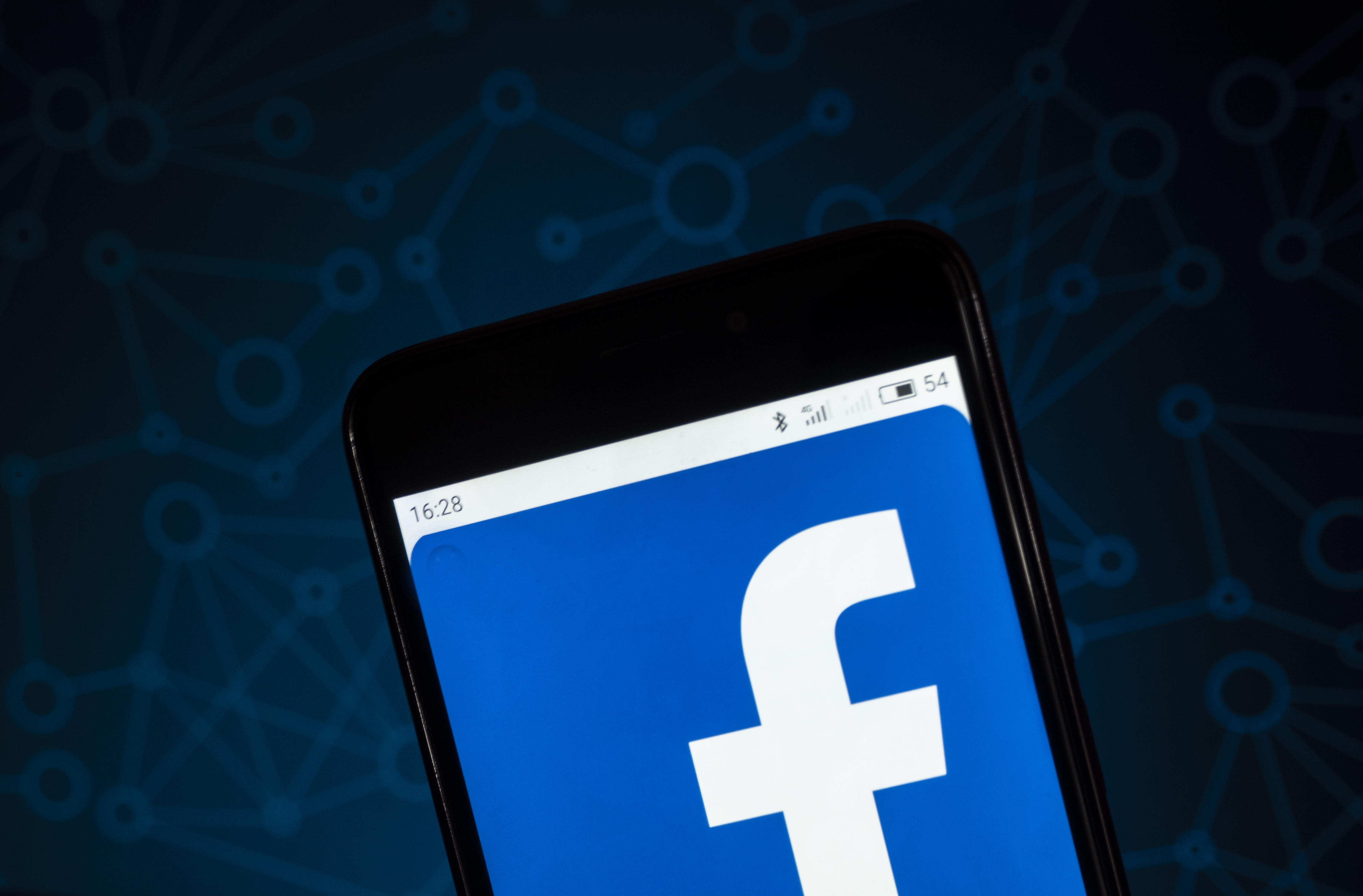 The Facebook logo seen displayed on a smart phone. According