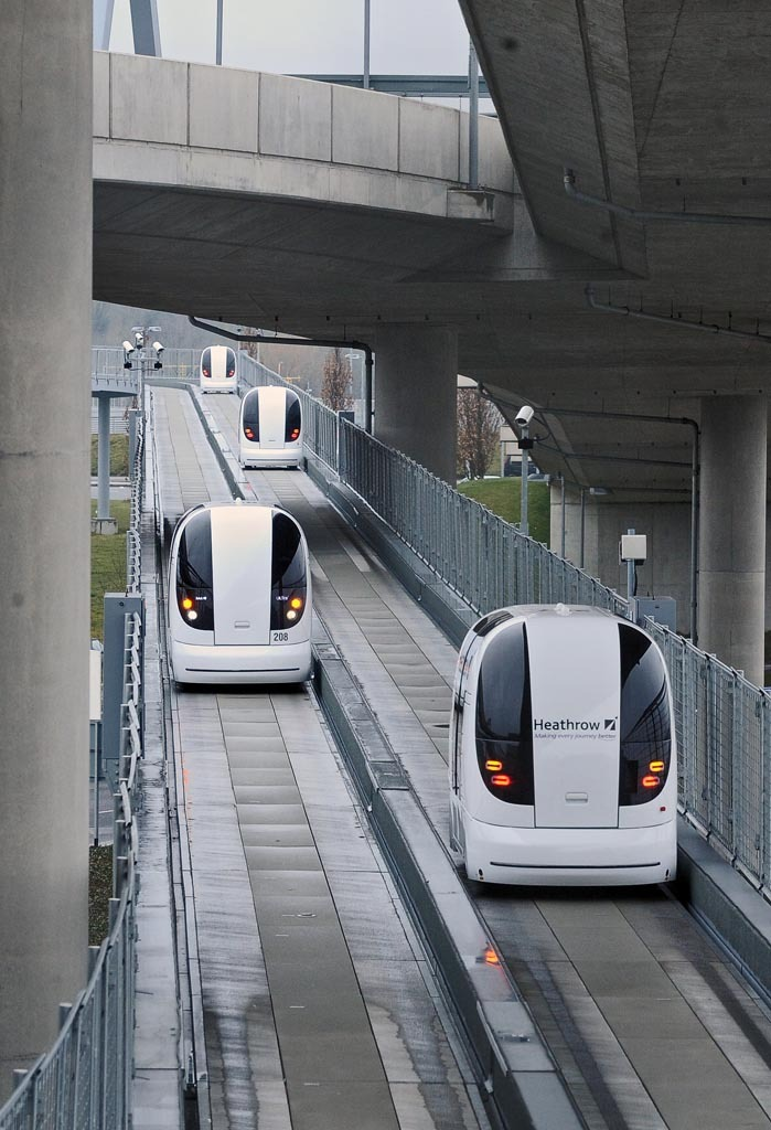 Pods traveling along dedicated roadway