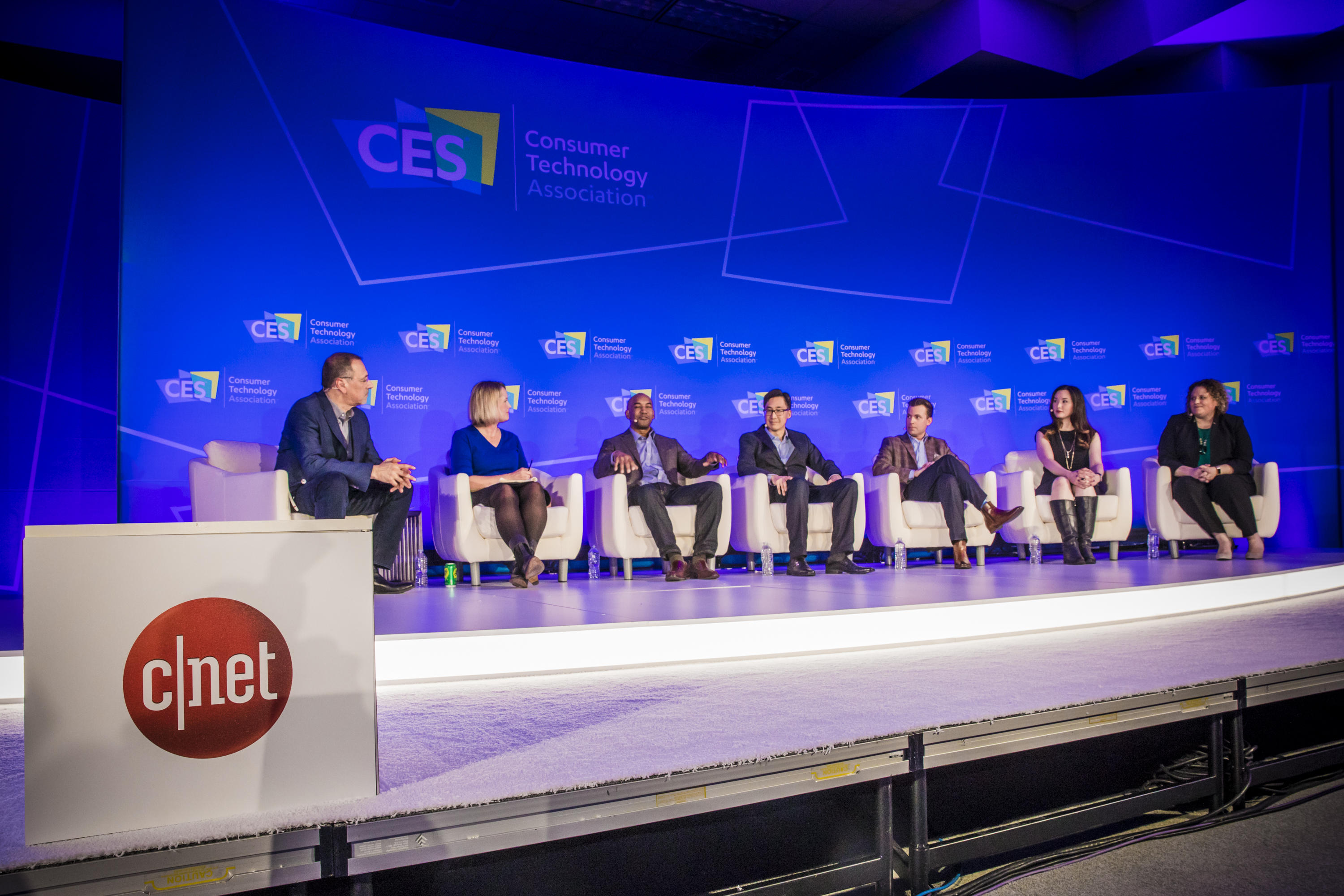 Panelists sit in a row onstage at CES. (Left to Right) Panel moderators Brian Cooley and Lindsey Turrentine of CNET sit next to Ian Tong, Chief Medical Officer at Doctor On Demand; David Rhew, chief medical officer and head of healthcare and fitness at Sa