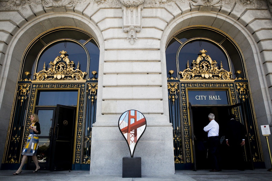 Marissa Mayer, left, Google's Vice President of Search Products & User Experience leaves San Francisco City Hall Wednesday July 15, 2009 after announcing Google's Favorite Places, a map customization initiative in which celebrities have mapped their most cherished spots around the world. Location markers, like the on seen in the center of this image, have been placed at notable San Franciscans' favorite spots.
