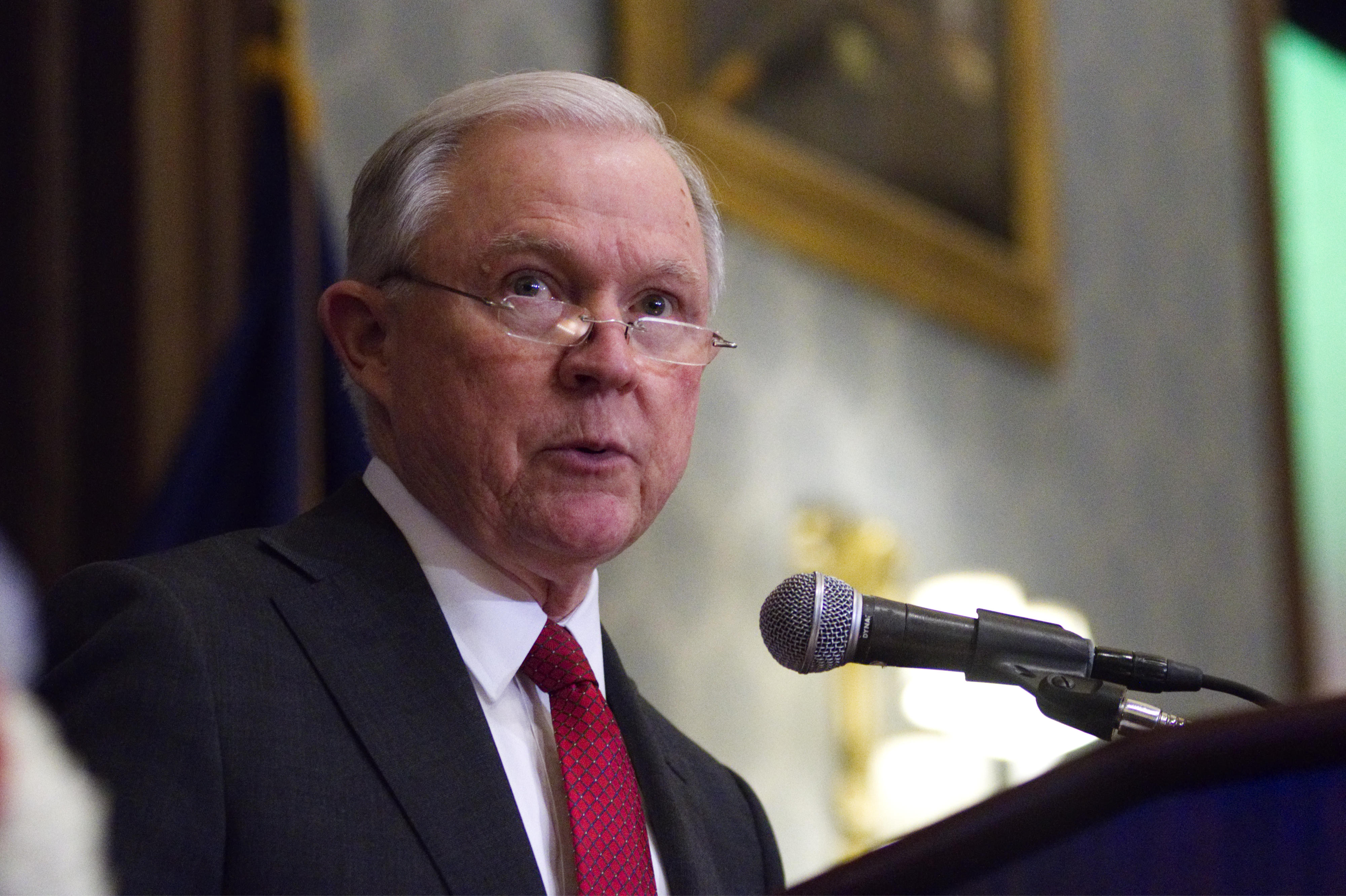 Attorney General Jeff Sessions stands at a podium. Sessions announced a cybersecurity task force composed of members from several government agencies and divisions of the Justice Department Tuesday. Their focus will be the abuse of technology.