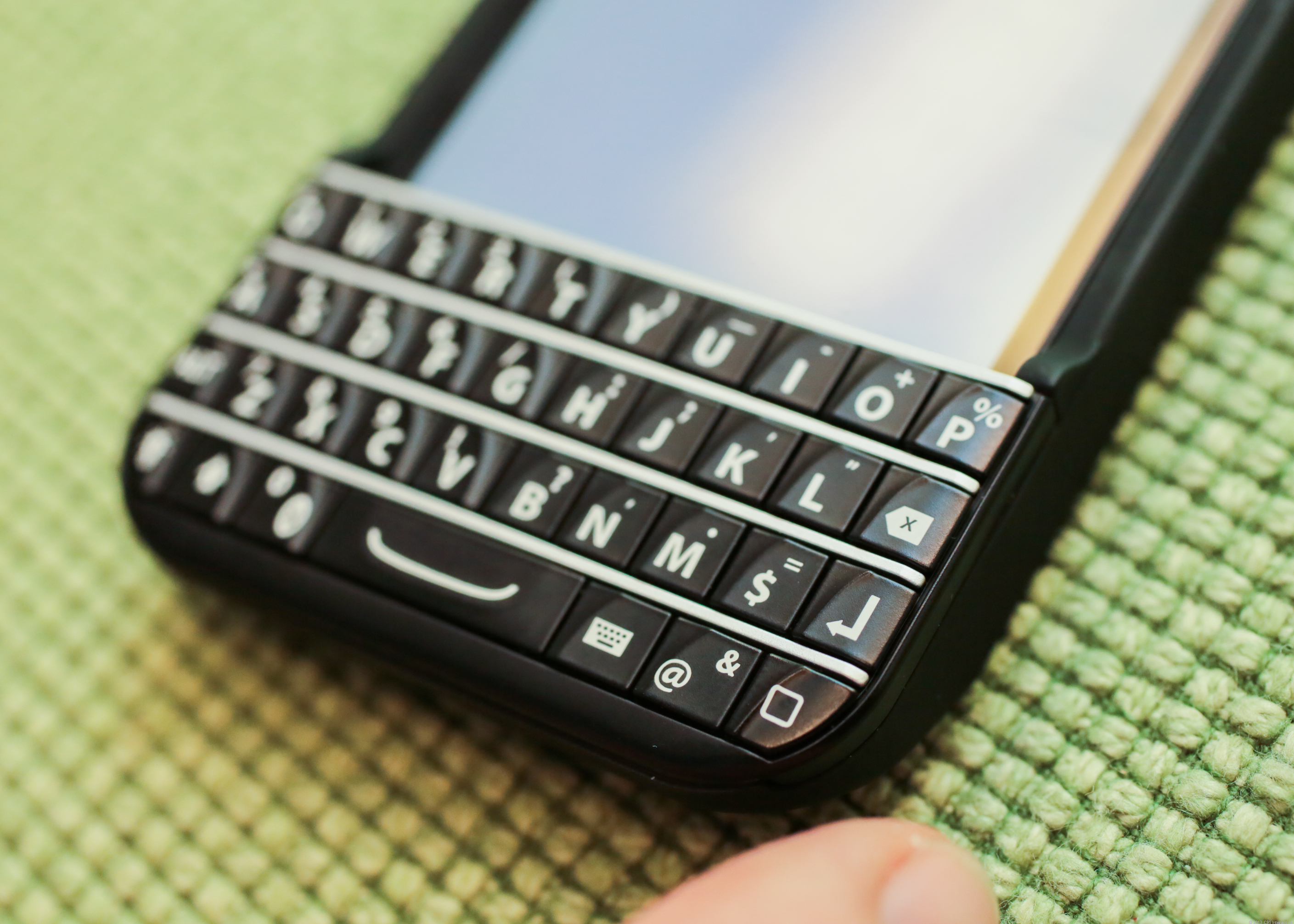 The Typo Keyboard snaps around an iPhone 5 or 5S, giving a BlackBerry-like hardware keyboard to people who want more than the iPhone's screen keyboard.