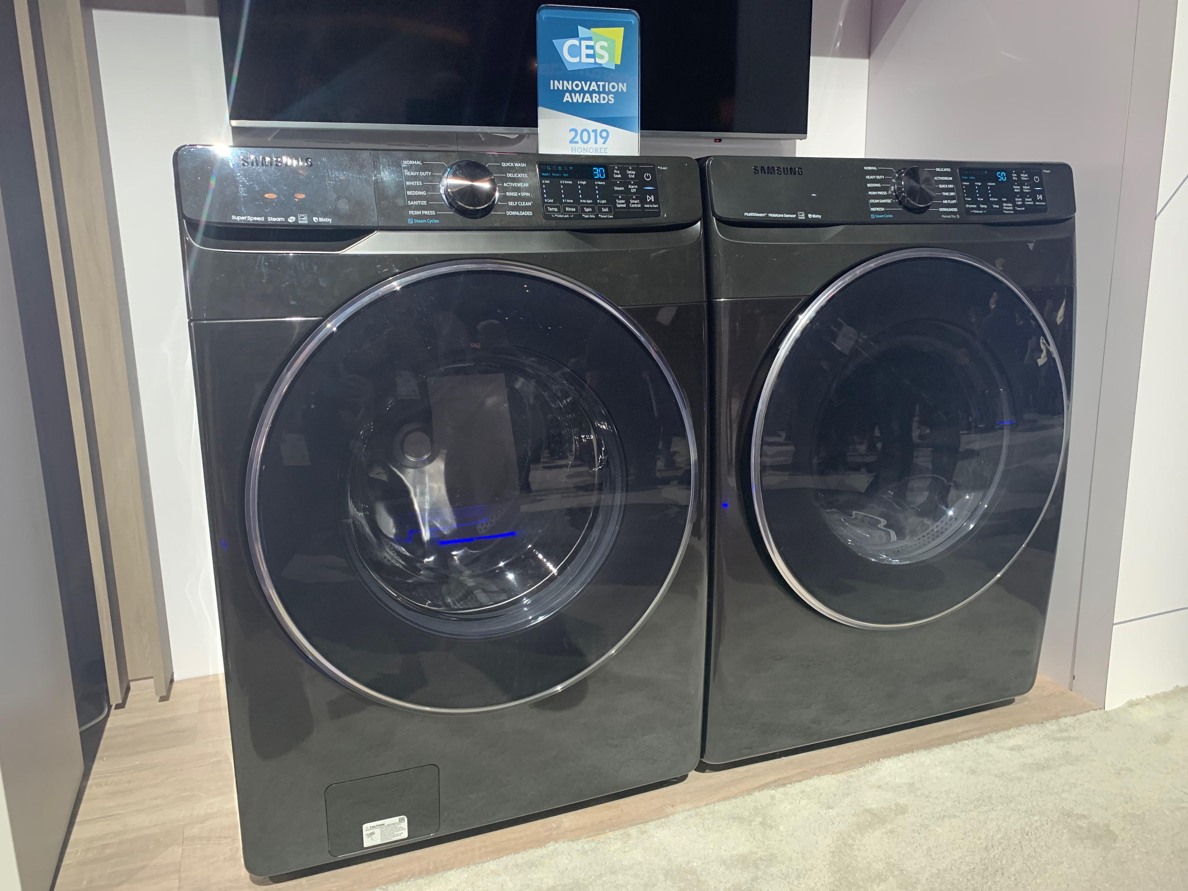 <p>Samsung's new smart washer and dryer combo, on display at CES 2019.</p>