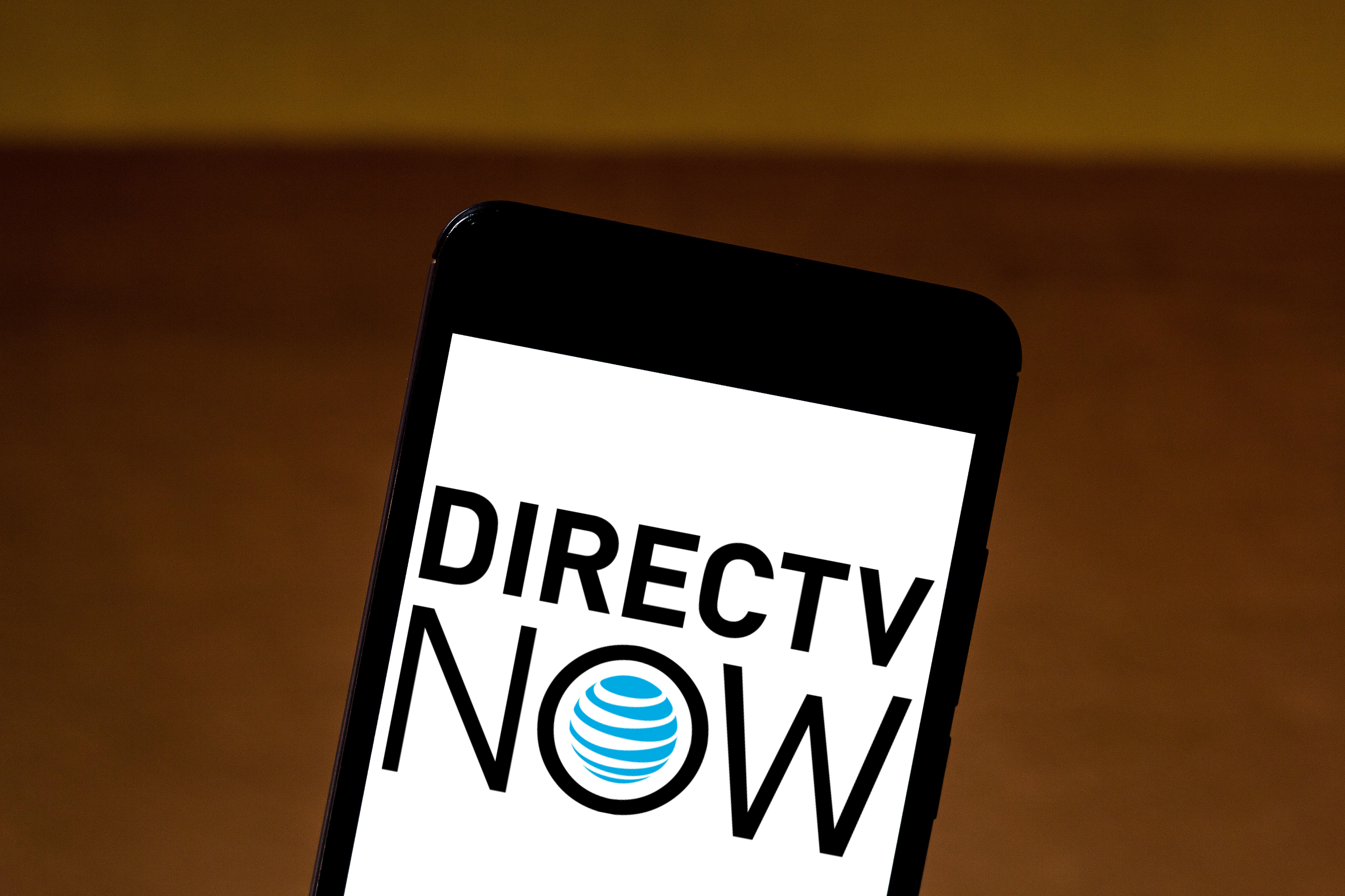 The DirecTV Now logo on a smartphone screen.