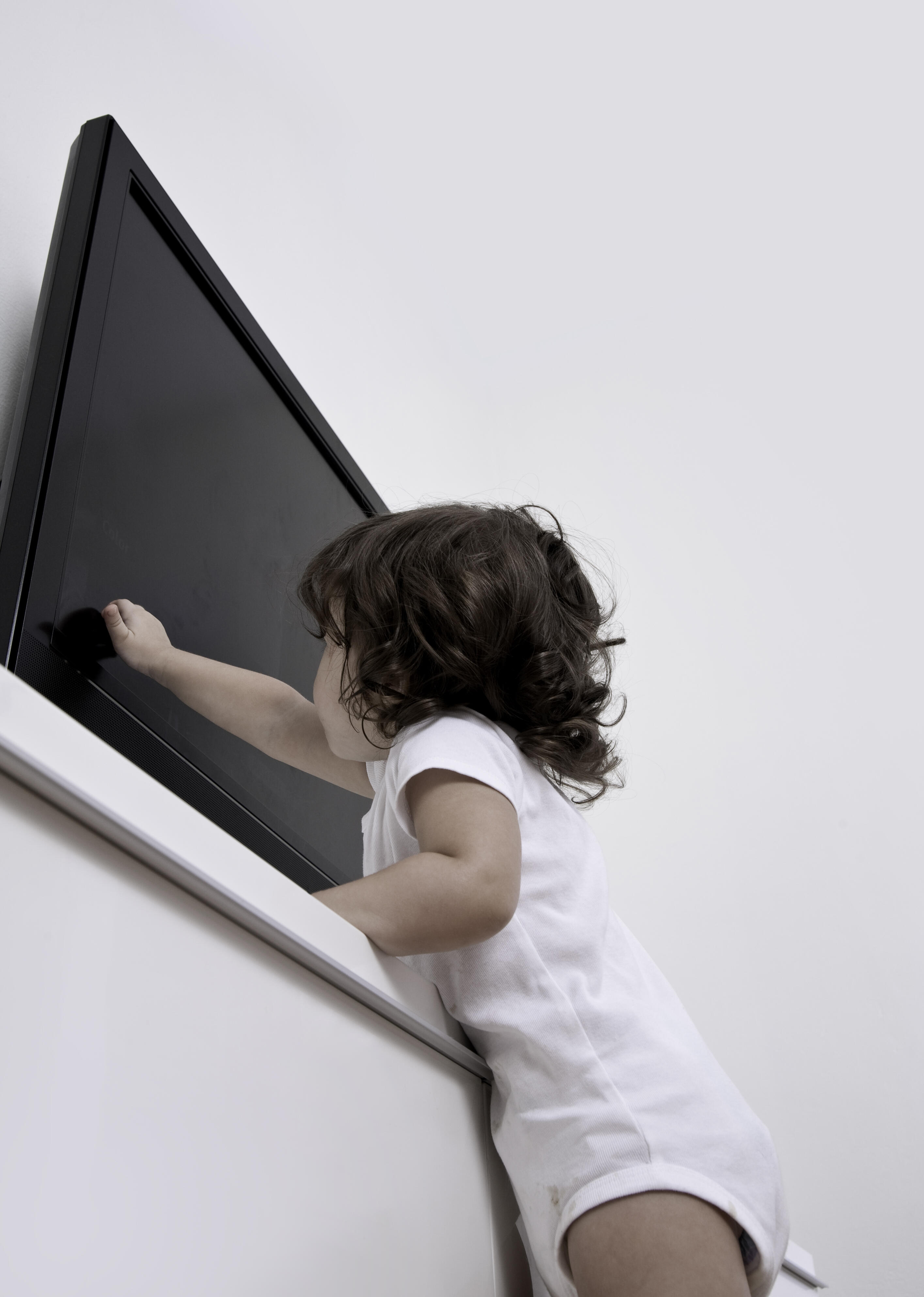 Secure your TV to the wall to help prevent accidents with children and pets.