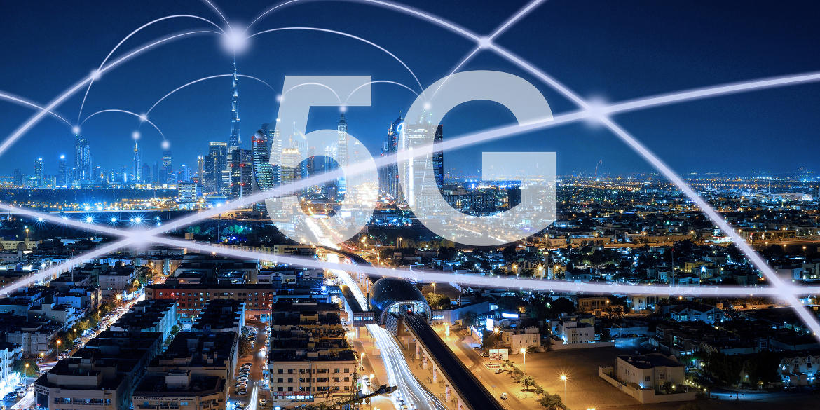 The term 5G floats atop a nighttime view of a city skyline. Curved lines of light represent speedy connections.