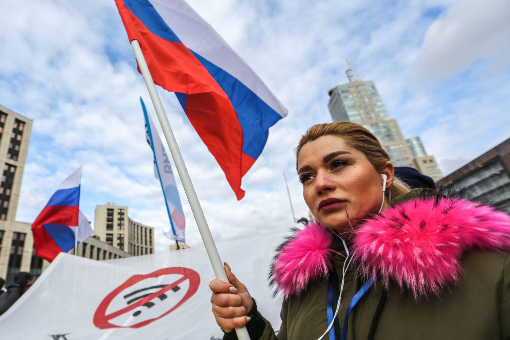 A protester seen holding a flag during the demonstration.