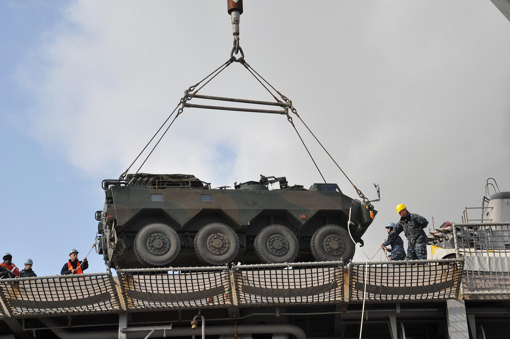Loading a Japanese armored truck onto the flight deck