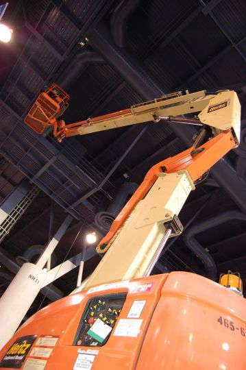 Cherry picker hangs cables from the ceiling of North Hall